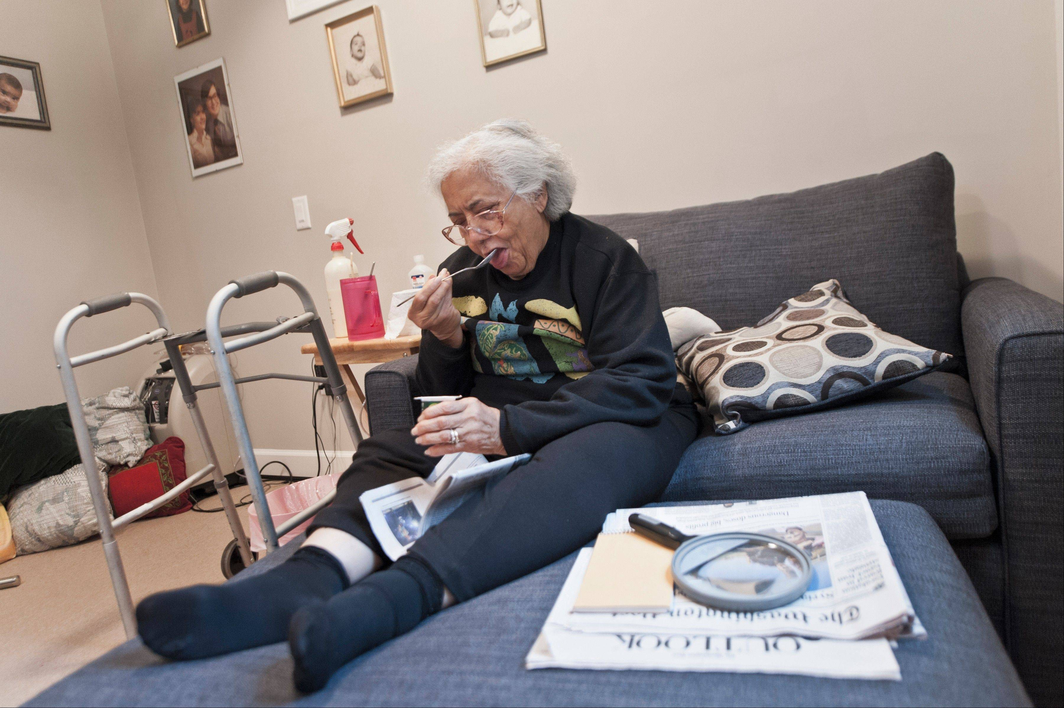 Viola Baez eats yogurt in a MedCottage installed in her daughter�s Alexandria, Va., backyard. The high-tech cottage, which some believe could change the face of elderly care, is an option to a nursing home.