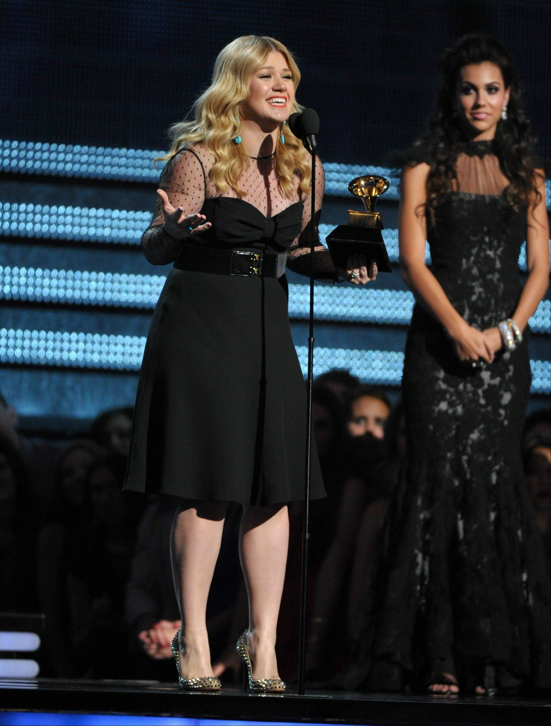"Kelly Clarkson accepts the award for best pop vocal album for ""Stronger"" at the 55th annual Grammy Awards on Sunday, Feb. 10, 2013, in Los Angeles."