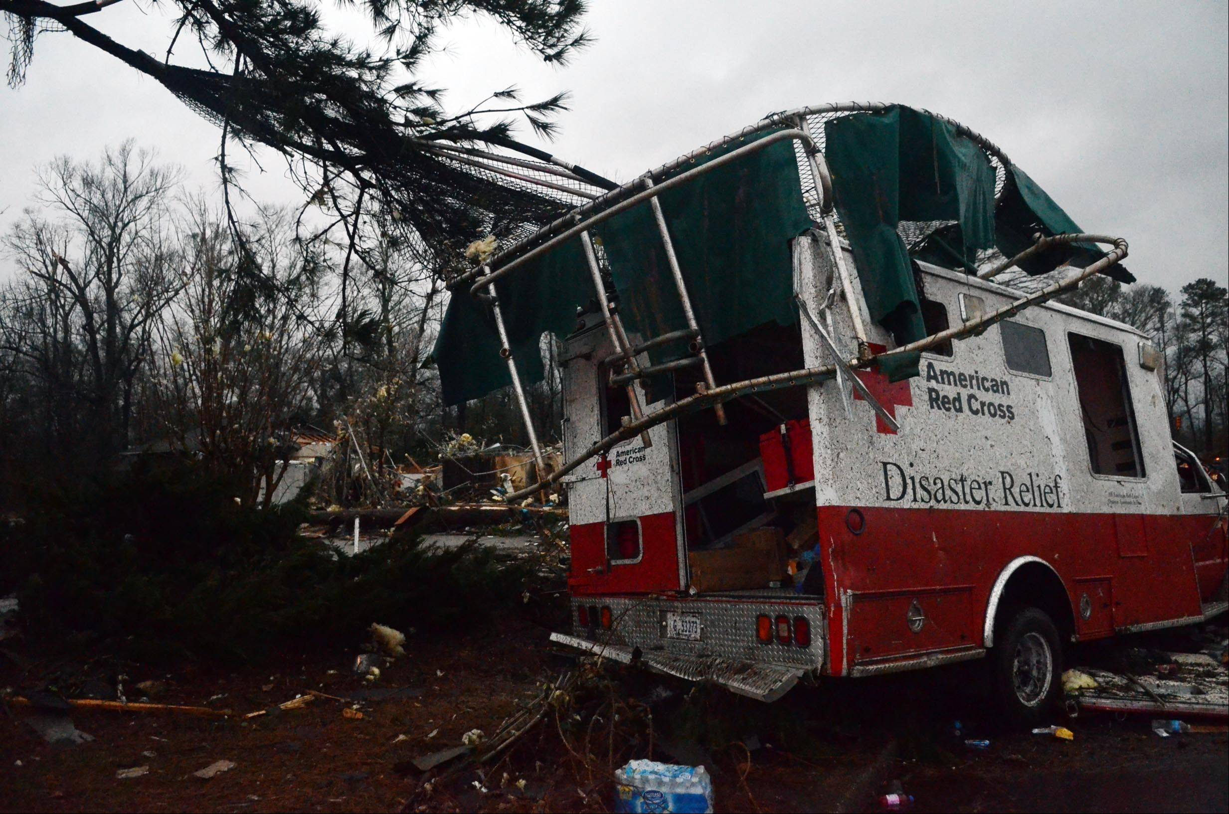 A trampoline rests on top of a damaged American Red Cross disaster relief truck outside of the Hattiesburg American Red Cross center, which was destroyed by an apparent tornado that moved through Hattiesburg, Miss., Sunday.
