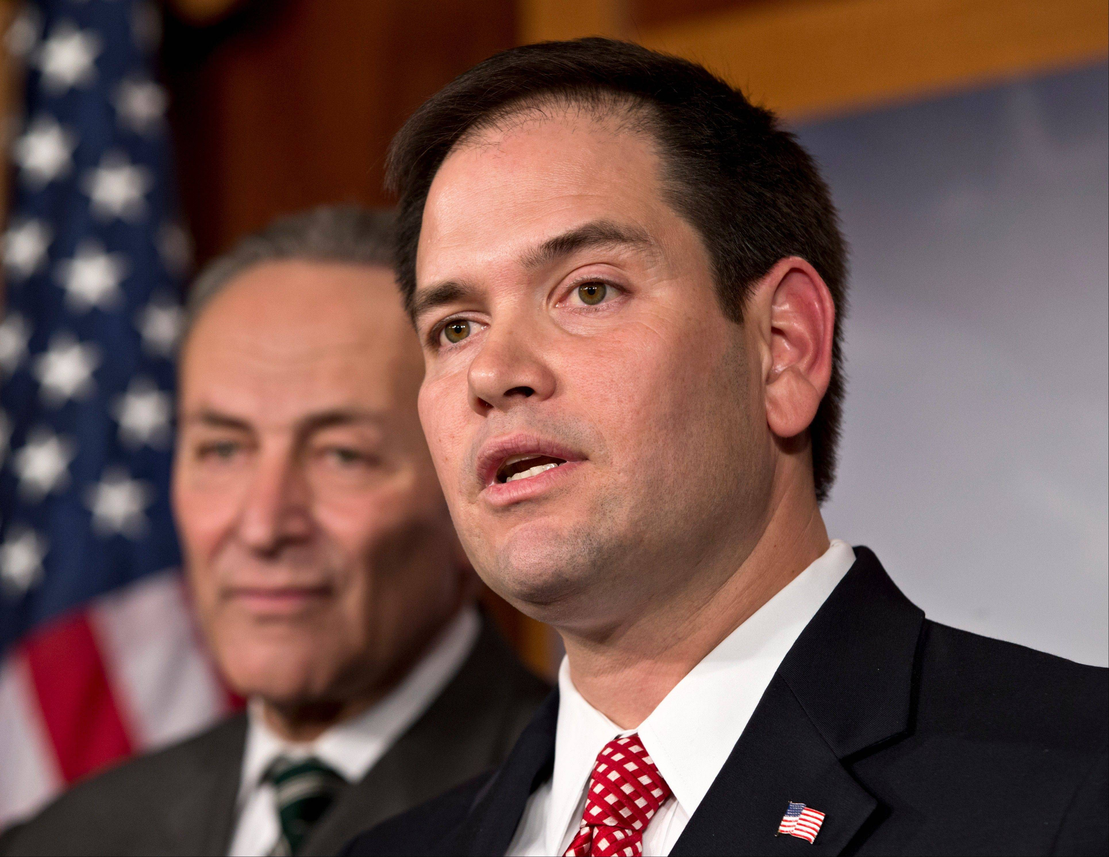 Sen. Marco Rubio, right, and Sen. Charles Schumer, left, are part of a bipartisan group of leading senators to announce that they have reached agreement on the principles of sweeping legislation to rewrite the nation�s immigration laws.
