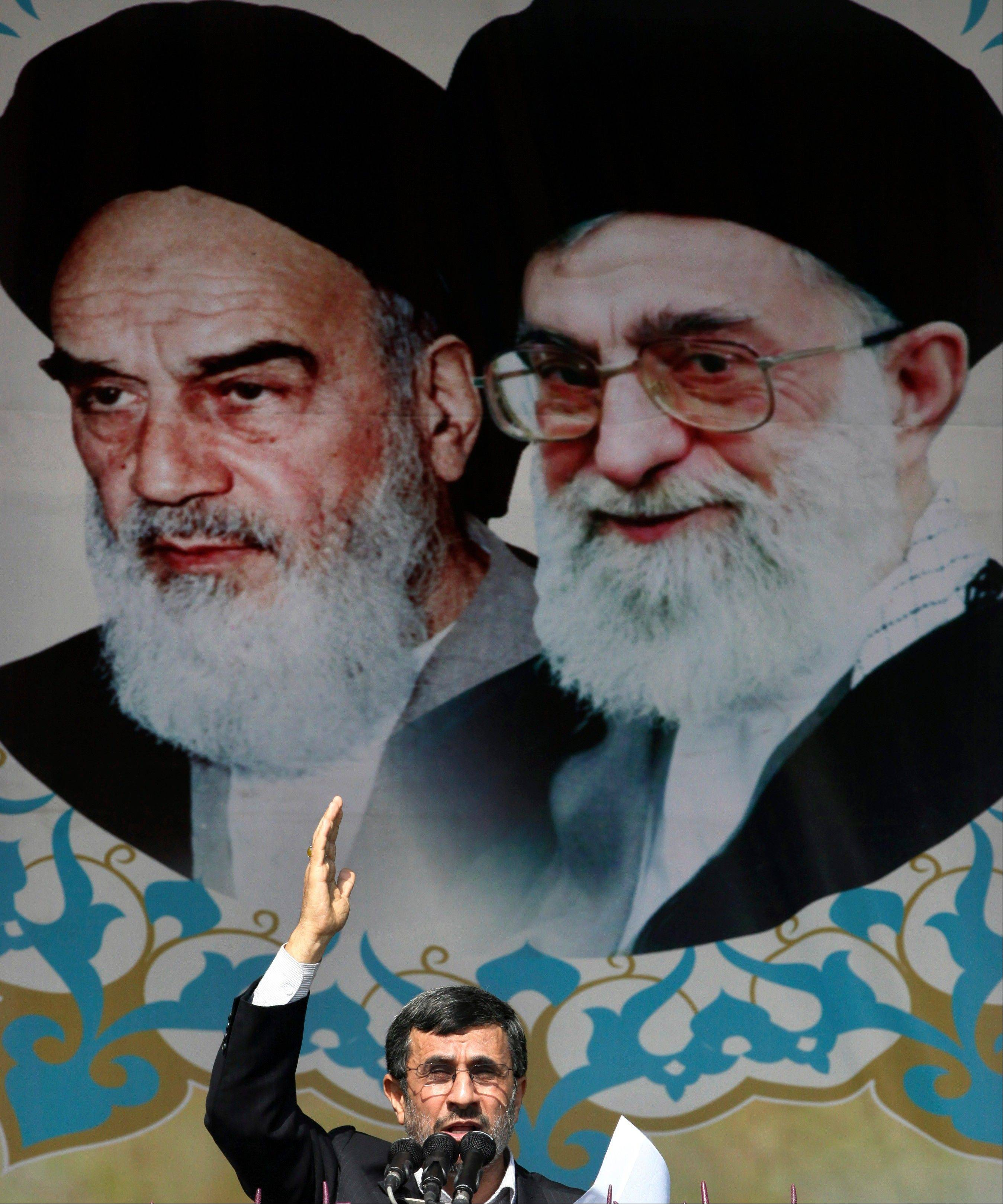 Iranian President Mahmoud Ahmadinejad speaks under portraits of the late Ayatollah Khomeini, left, and Supreme Leader Ayatollah Ali Khamenei on Sunday during an annual rally commemorating the anniversary of the 1979 Islamic Revolution.