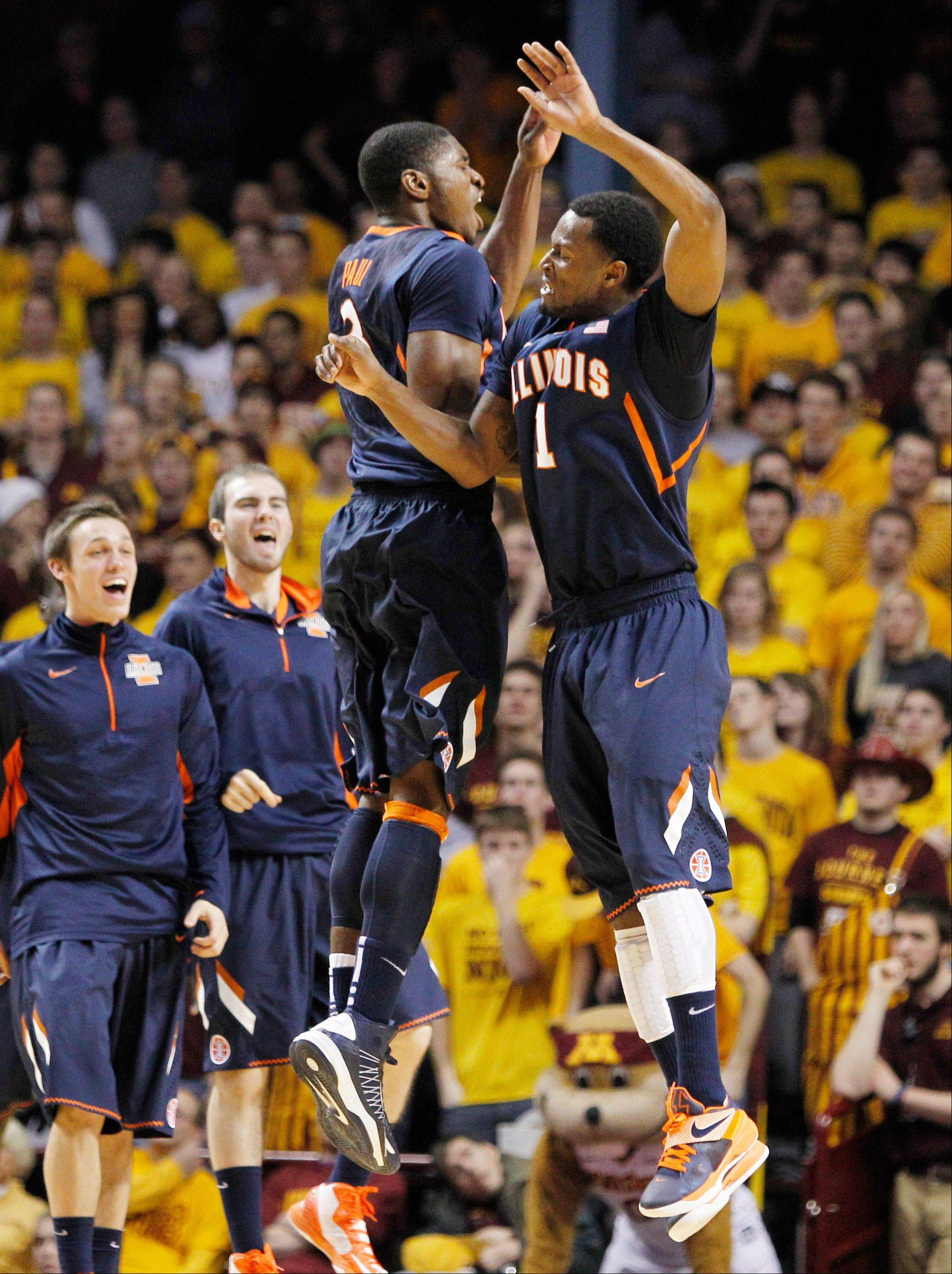 Illinois� D.J. Richardson (1) celebrates with Brandon Paul (3) after Richardson hit a 3-pointer against Minnesota during the first half of an NCAA college basketball game, Sunday, Feb. 10, 2013, in Minneapolis.