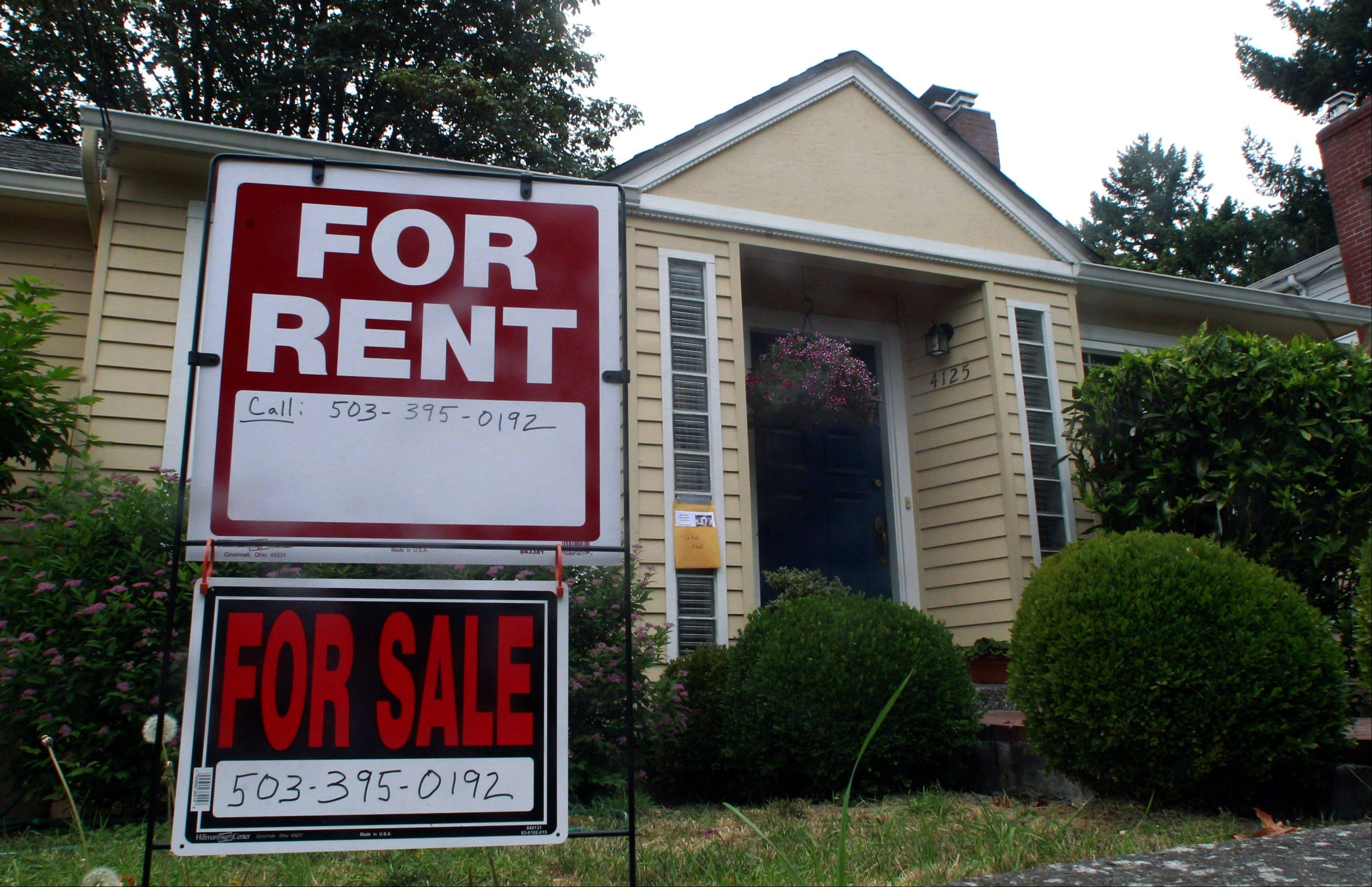 A house is for rent an for sale in Portland, Ore. Experts say owning rental housing can pay off even as market recovers.