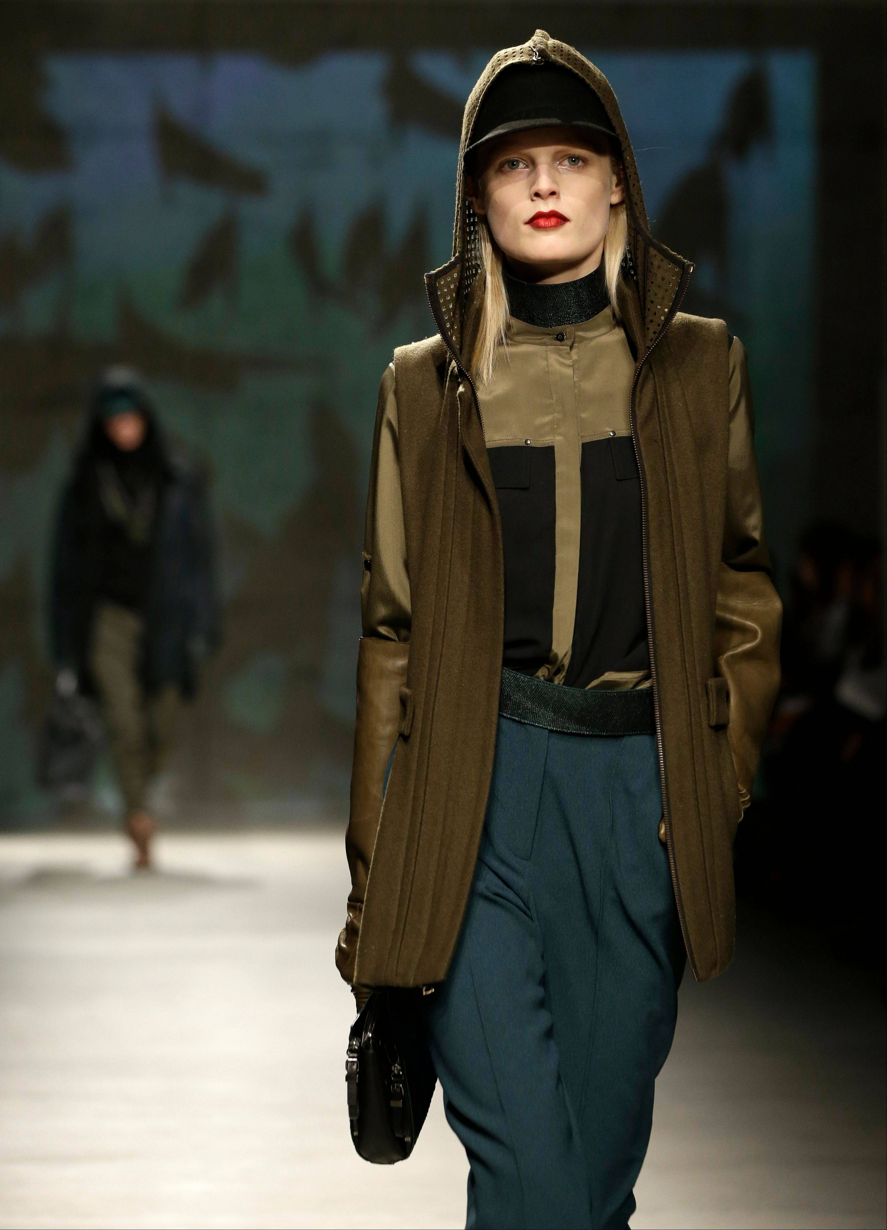A model walks the runway at the presentation of the Kenneth Cole Fall 2013 fashion collection during Fashion Week in New York.