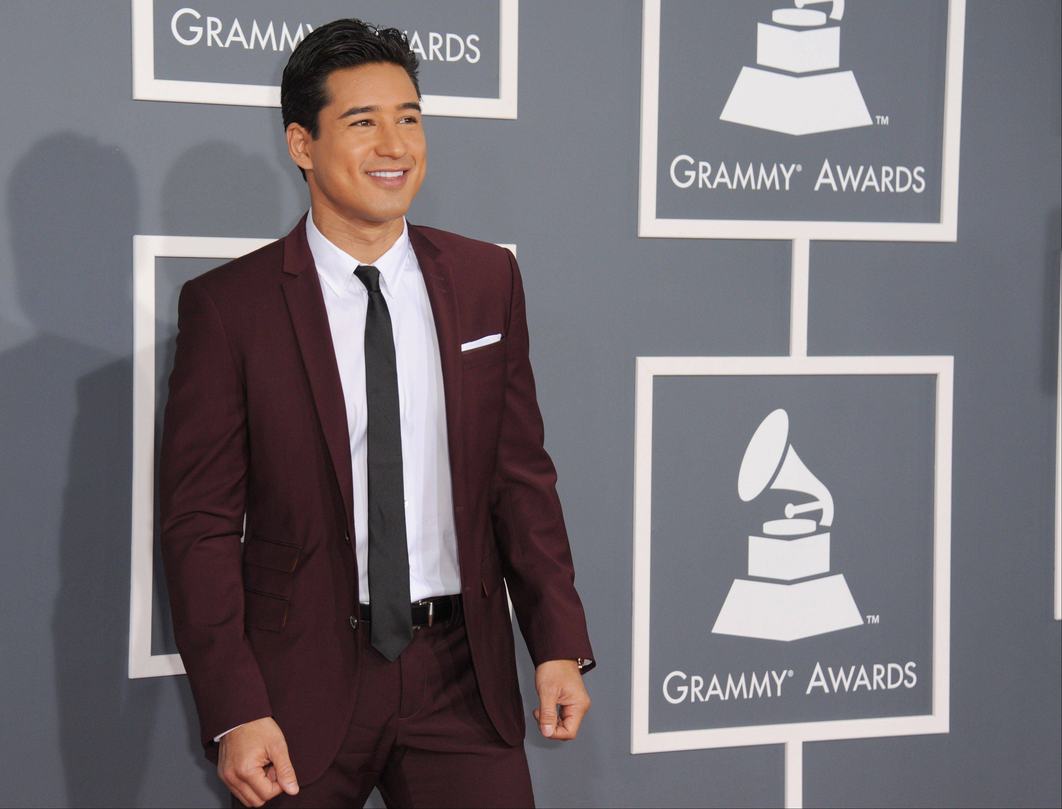 """X Factor"" Mario Lopez arrives at the 55th annual Grammy Awards on Sunday, Feb. 10, 2013, in Los Angeles."