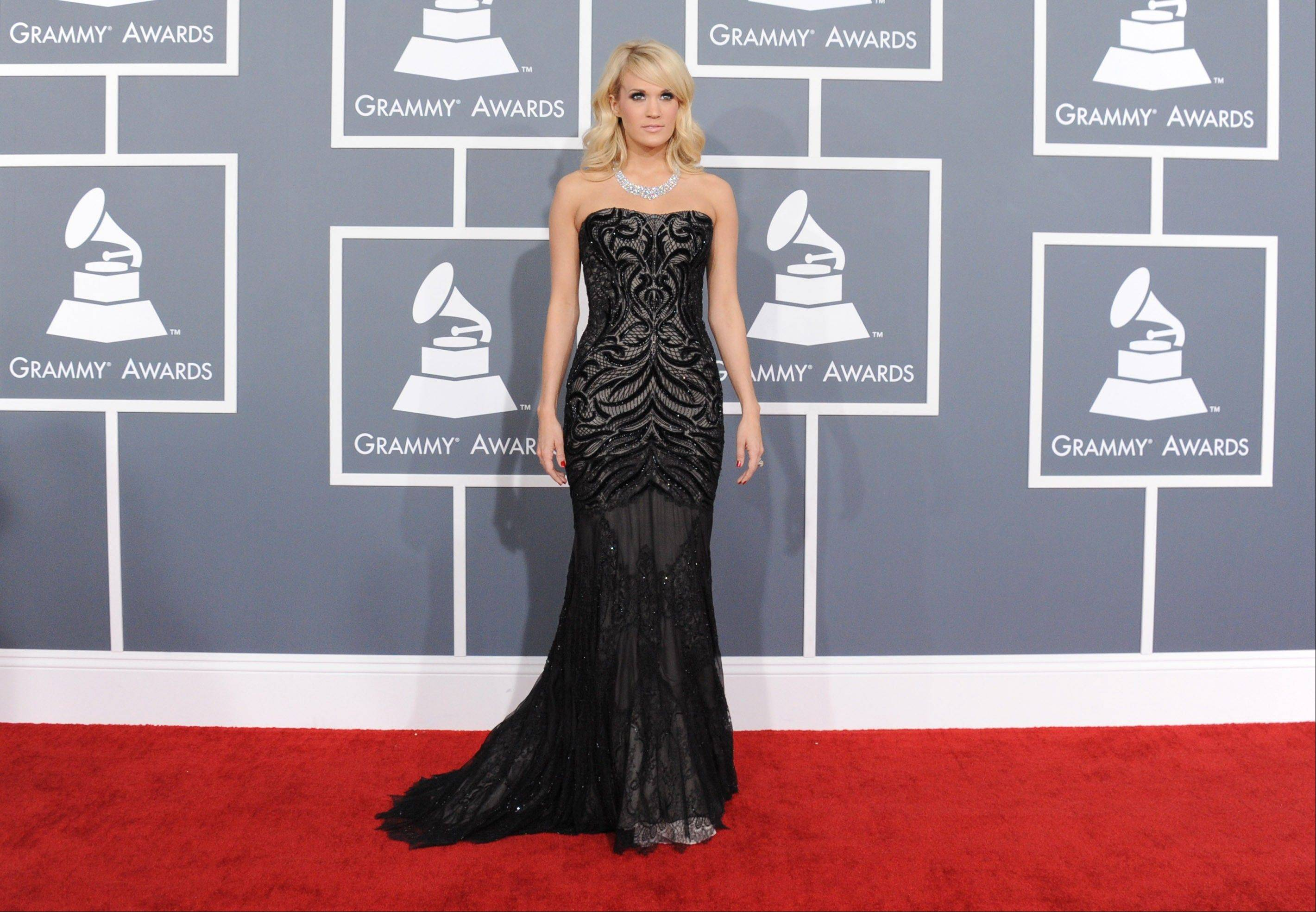 Country singer Carrie Underwood arrives at the 55th annual Grammy Awards on Sunday, Feb. 10, 2013, in Los Angeles.