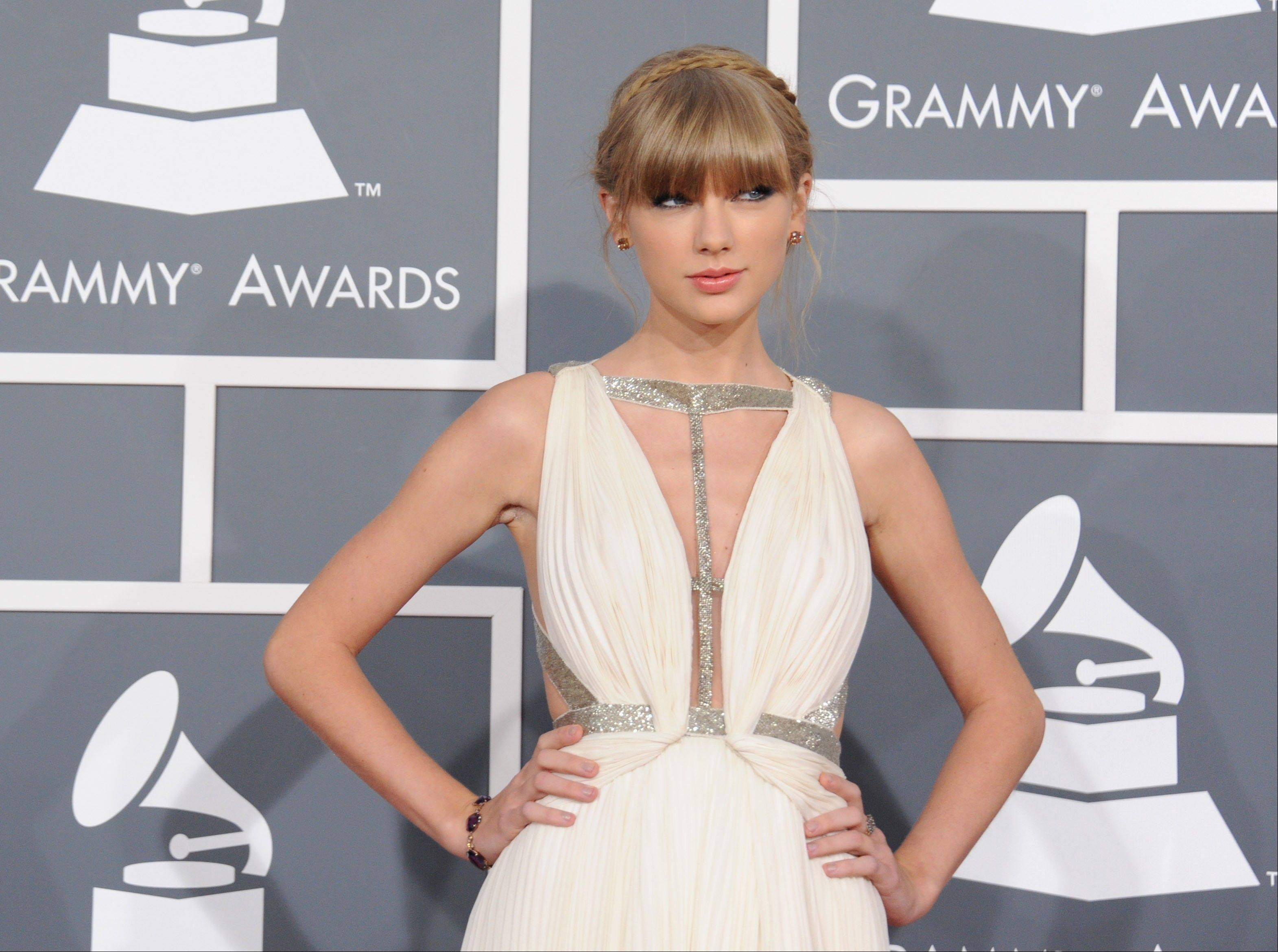 Singer-songwriter Taylor Swift arrives at the 55th annual Grammy Awards on Sunday, Feb. 10, 2013, in Los Angeles.