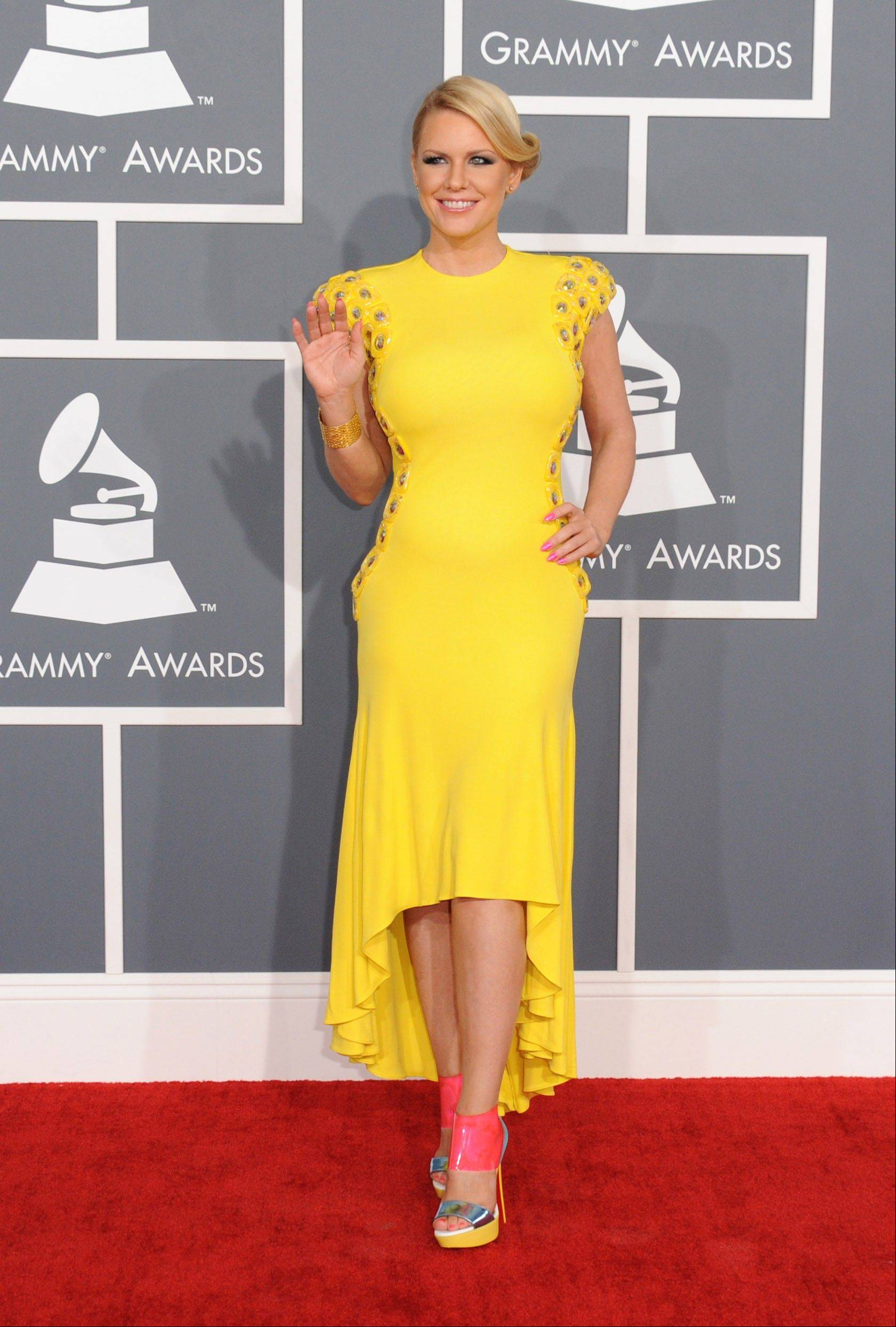 Carrie Keagan arrives at the 55th annual Grammy Awards on Sunday, Feb. 10, 2013, in Los Angeles.