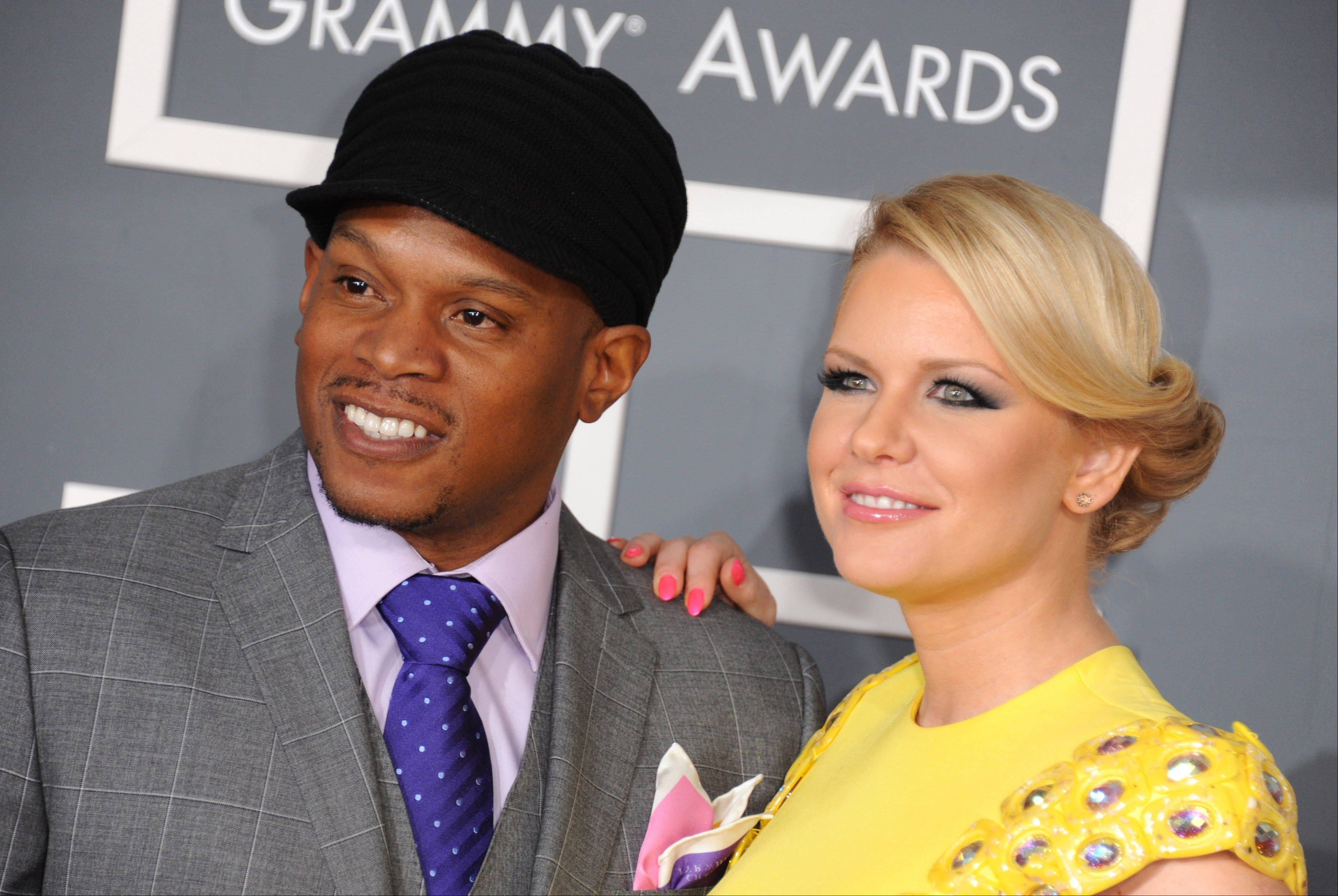 Sway, left, and Carrie Keagan arrive at the 55th annual Grammy Awards on Sunday, Feb. 10, 2013, in Los Angeles.