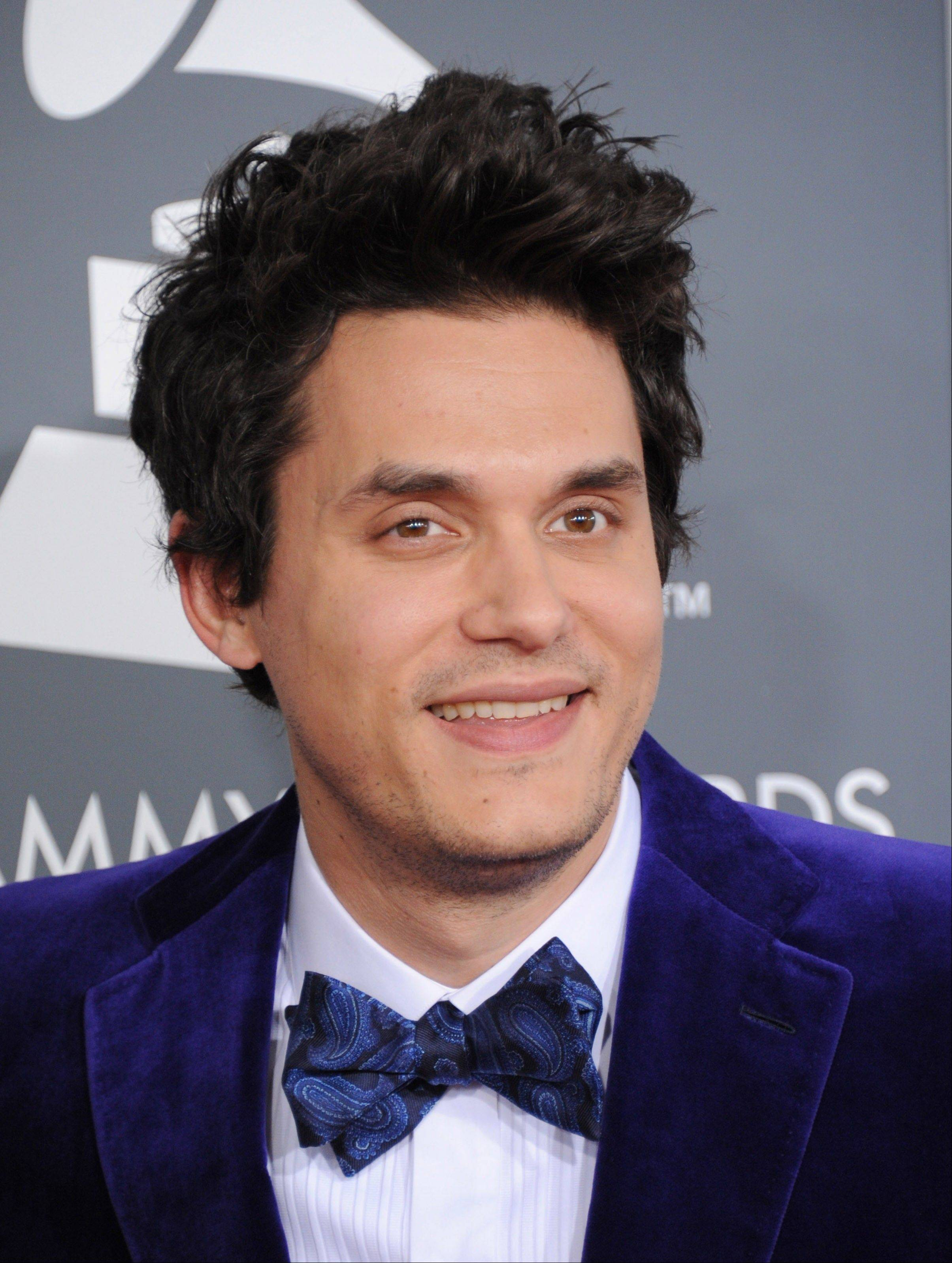 Musician John Mayer arrives at the 55th annual Grammy Awards on Sunday, Feb. 10, 2013, in Los Angeles.