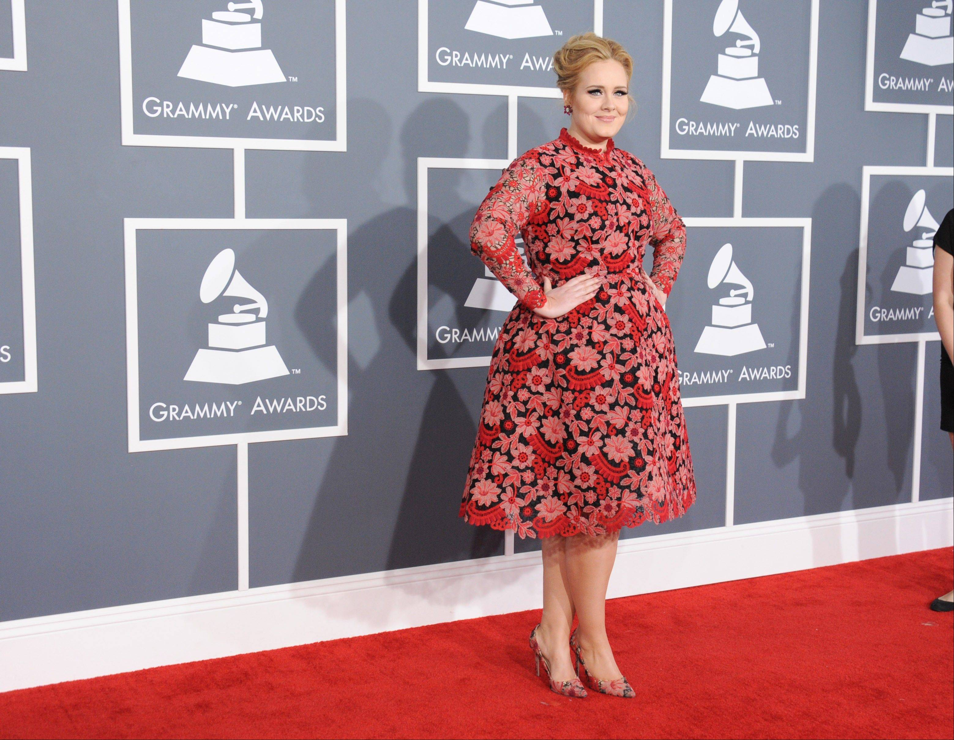 Singer-songwriter Adele arrives at the 55th annual Grammy Awards on Sunday, Feb. 10, 2013, in Los Angeles.