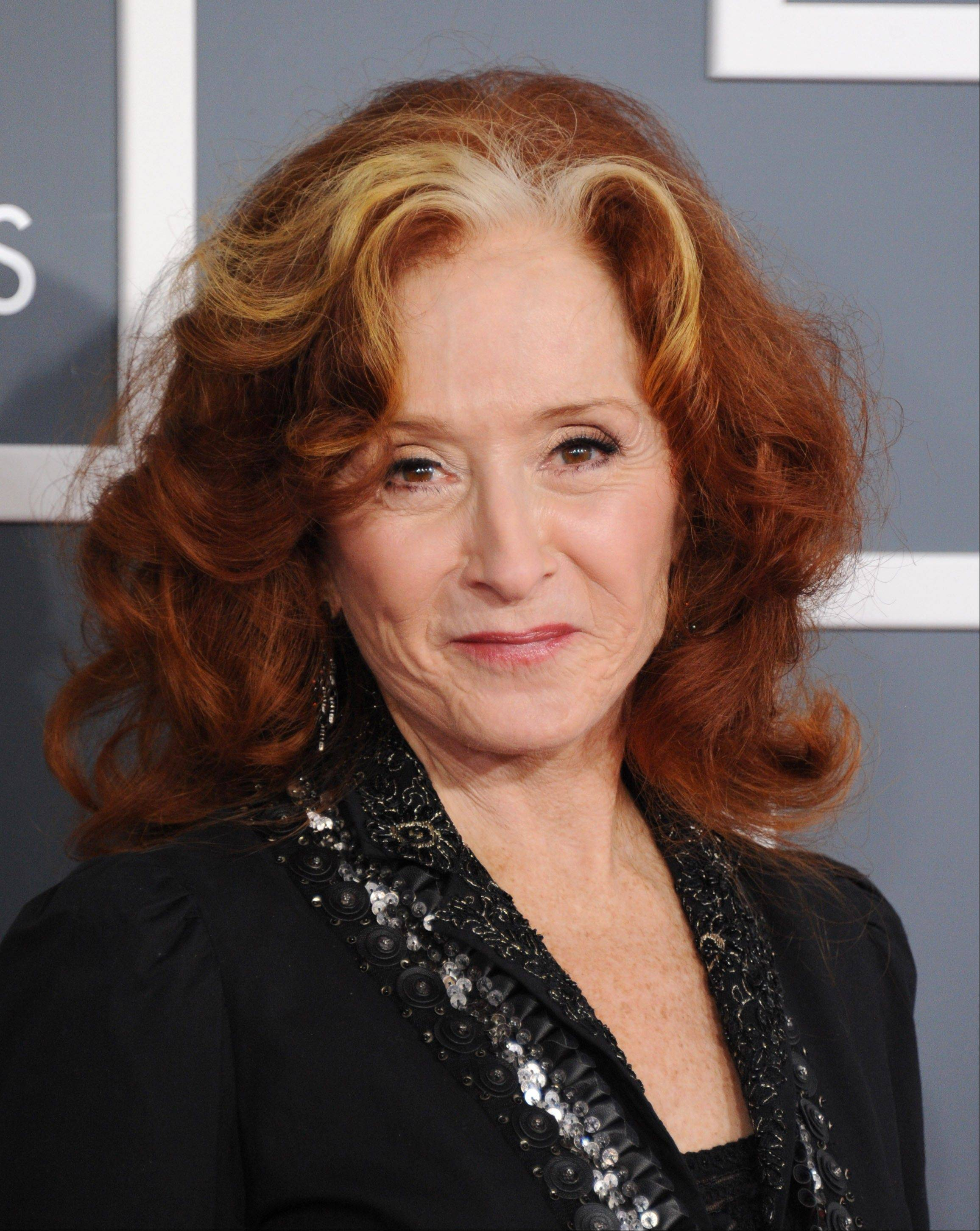 Bonnie Raitt arrives at the 55th annual Grammy Awards on Sunday, Feb. 10, 2013, in Los Angeles.
