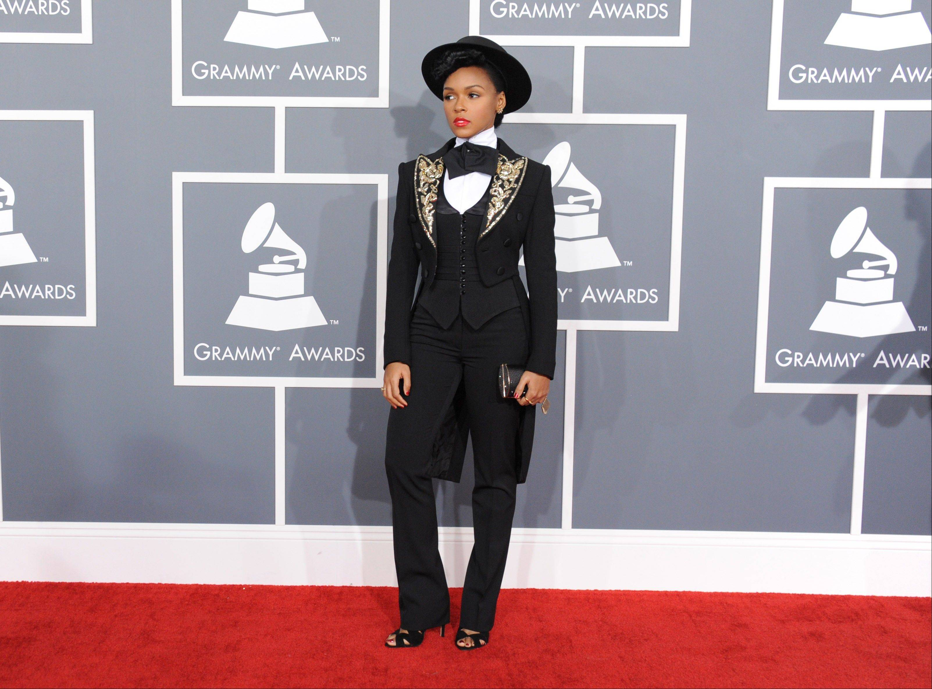 Janelle Monae arrives at the 55th annual Grammy Awards on Sunday, Feb. 10, 2013, in Los Angeles.