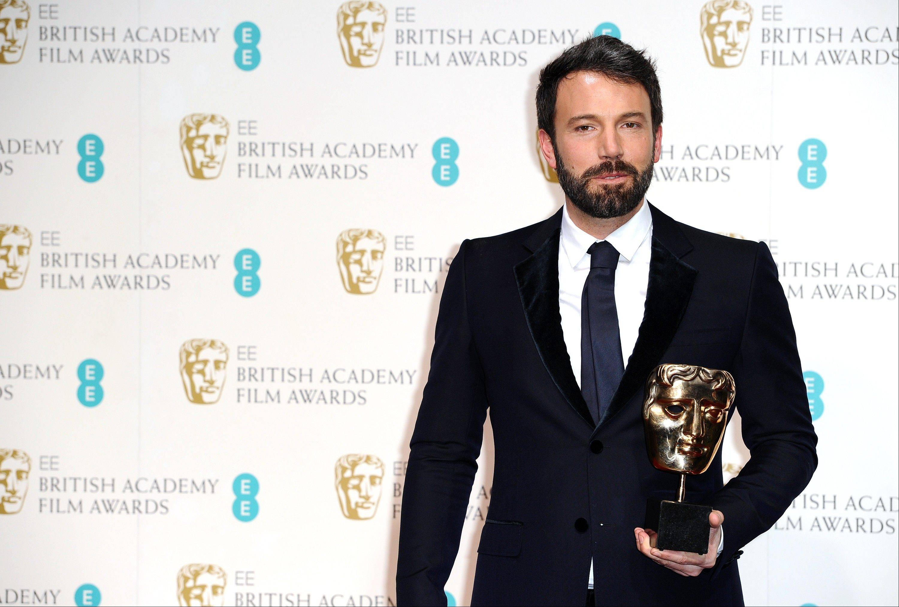"Actor and director Ben Affleck with the award for Best Film for ""Argo,"" at the BAFTA Film Awards at the Royal Opera House on Sunday, Feb. 10, 2013, in London."