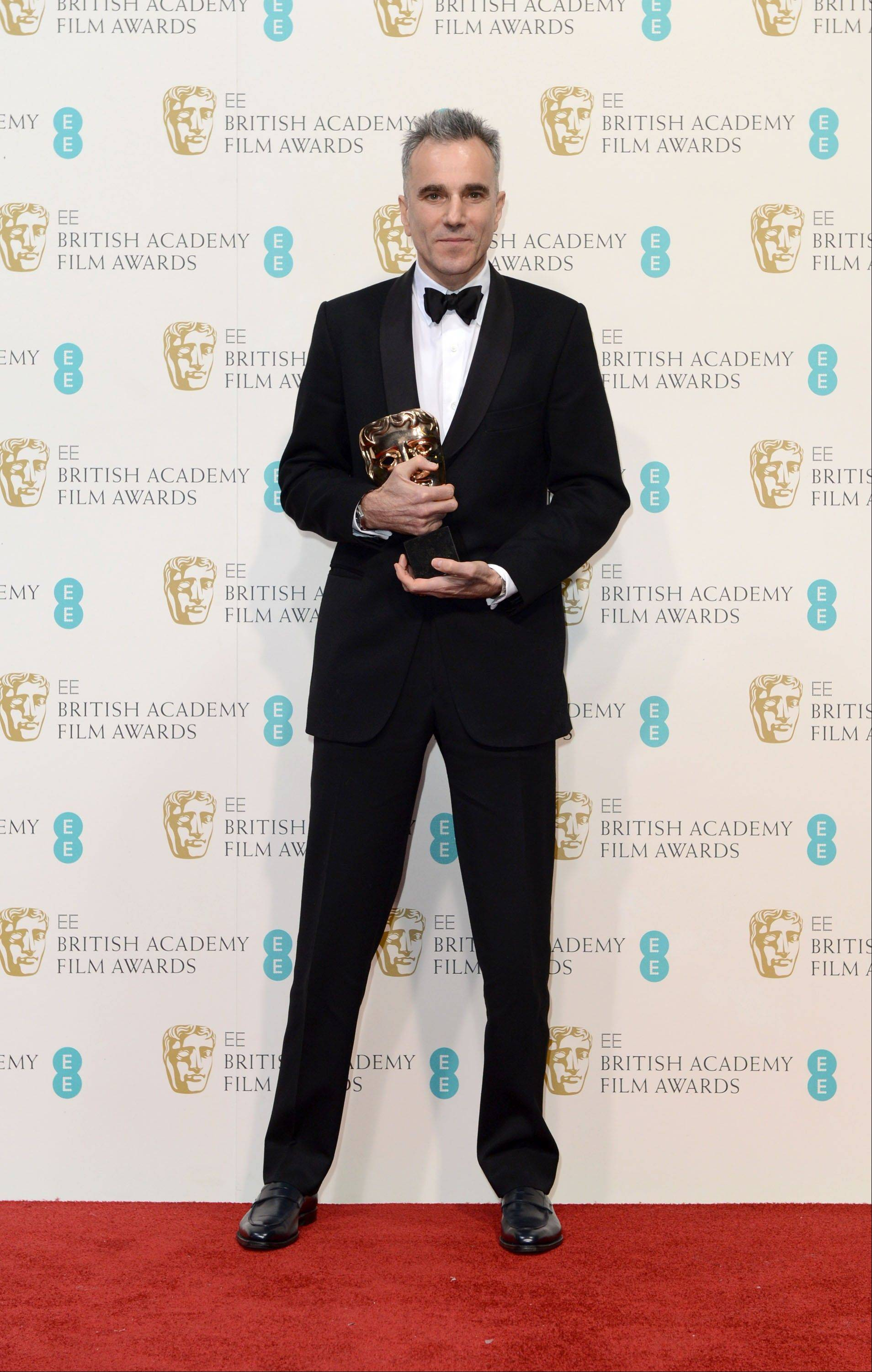 "Actor Daniel Day-Lewis holds the award for Leading Actor for his role in ""Lincoln,"" at the BAFTA Film Awards at the Royal Opera House on Sunday, Feb. 10, 2013, in London."