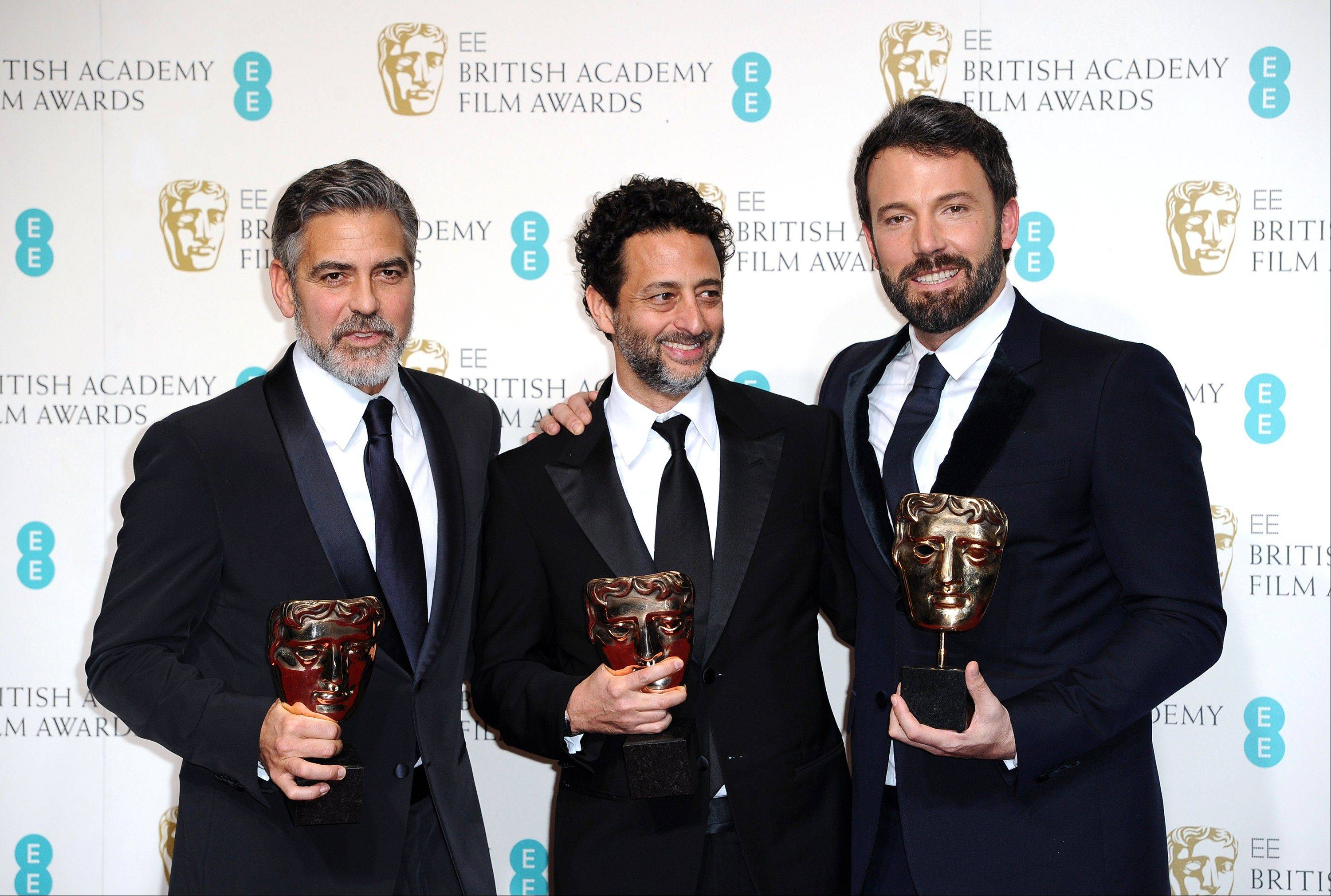 "Actors George Clooney, Grant Heslov, and Ben Affleck pose with the award for Best Film, for ""Argo,"" backstage at the BAFTA Film Awards at the Royal Opera House on Sunday, Feb. 10, 2013, in London. The film was produced by Clooney and Heslov and was directed by Affleck. Allfleck also starred in the film."