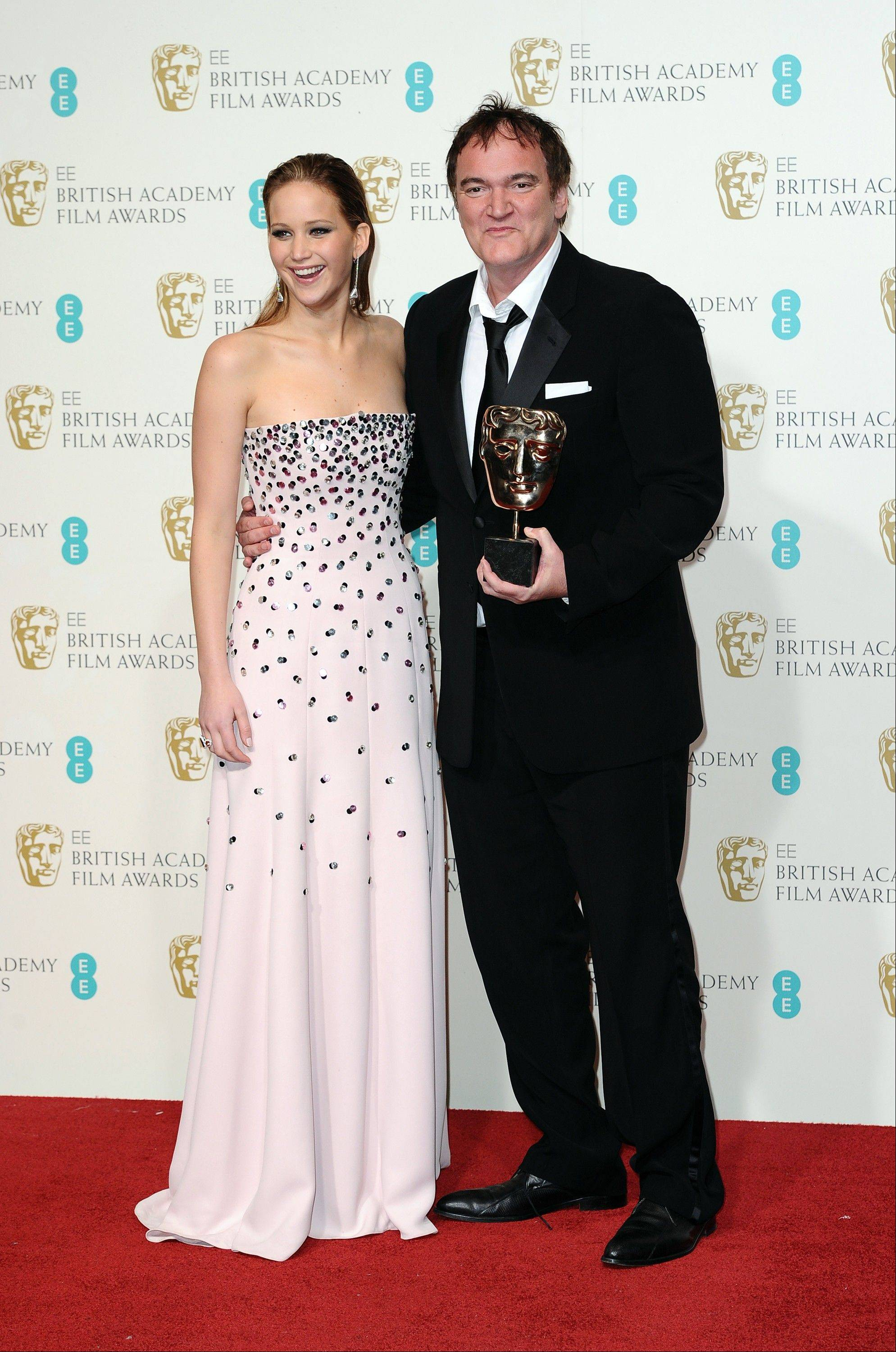 "Actress Jennifer Lawrence, poses with writer-director Quentin Tarantino as he holds the award for best Original Screenplay for ""Django Unchained,"" at the BAFTA Film Awards at the Royal Opera House on Sunday, Feb. 10, 2013, in London."