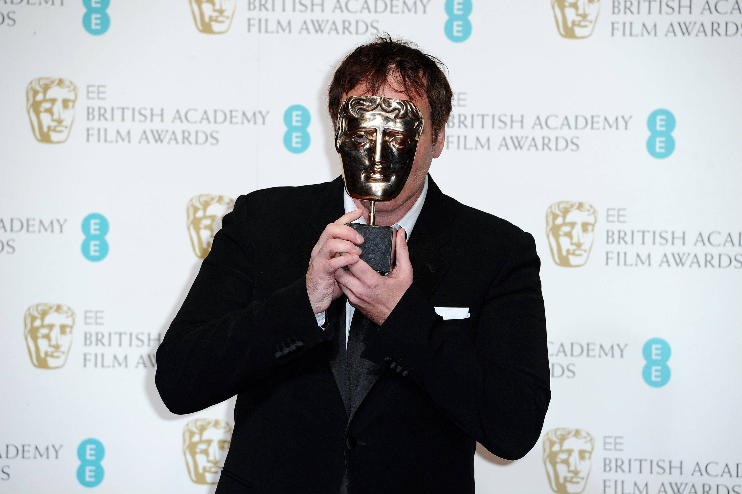 "Writer-director Quentin Tarantino holds the award for best Original Screenplay for ""Django Unchained,"" at the BAFTA Film Awards at the Royal Opera House on Sunday, Feb. 10, 2013, in London."
