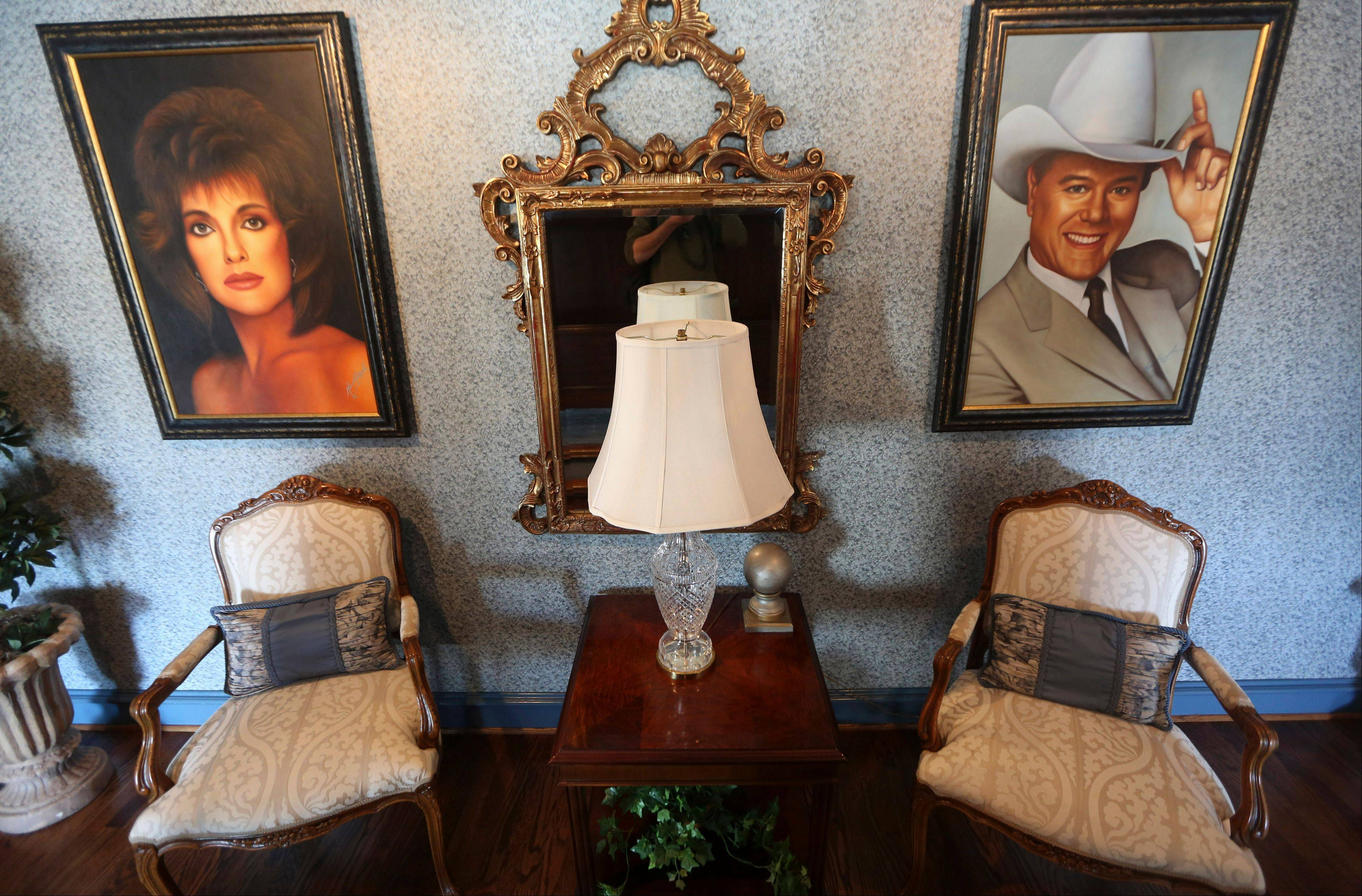 "Paintings of actors in the ""Dallas"" TV show are displayed in the mansion open to visitors at Southfork Ranch."