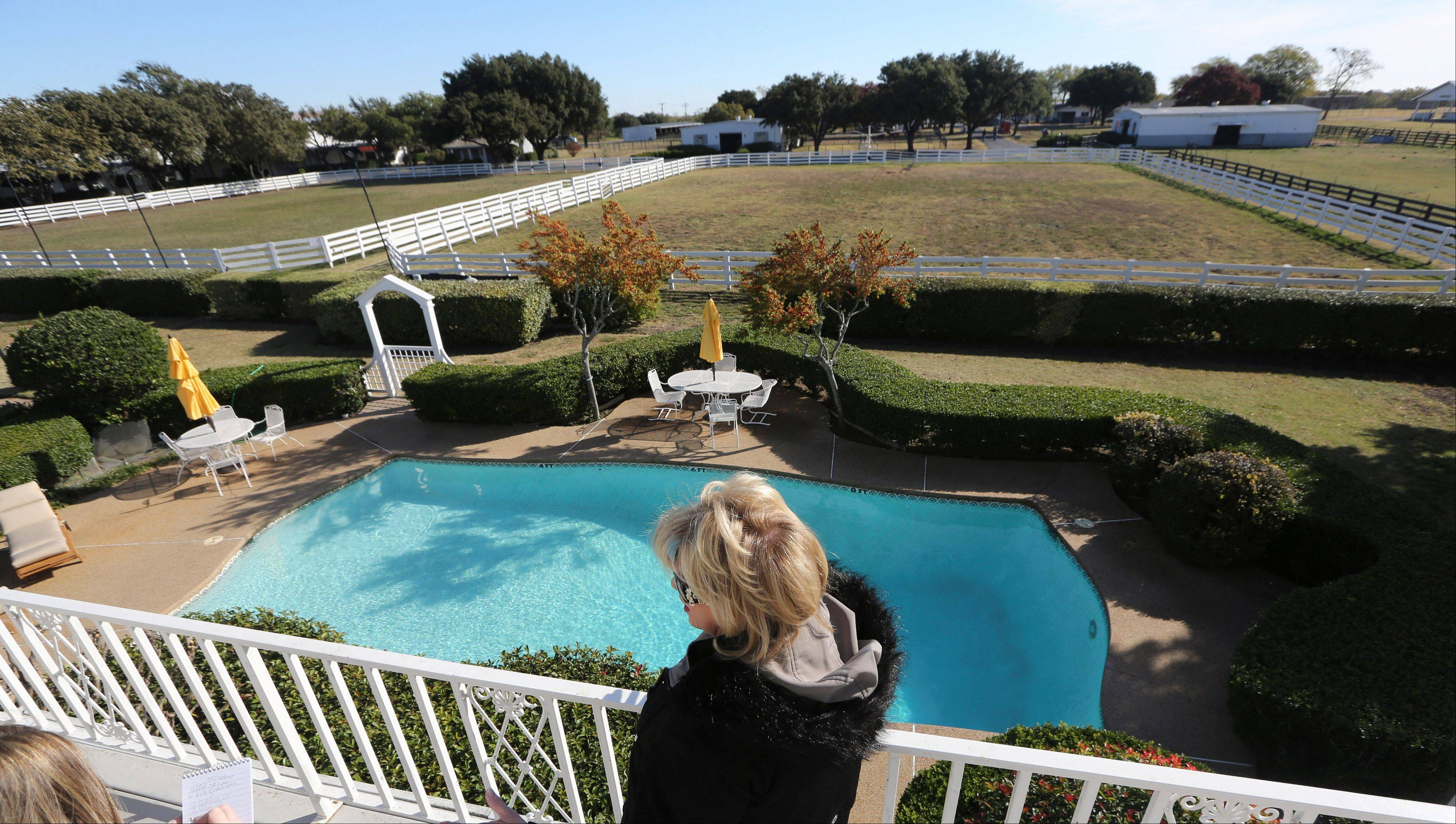 "Visitors take in the backyard pool of the mansion at Southfork Ranch made famous by the ""Dallas"" TV show."
