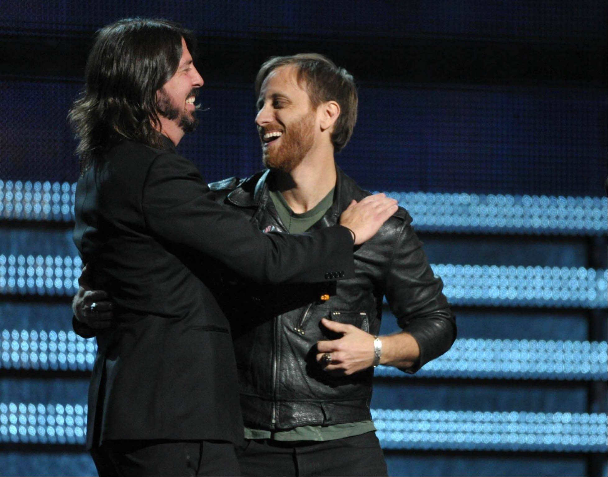"Dave Grohl of the Foo Fighters, left, presents the award for best rock performance for ""Lonely Boy"" to Dan Auerbach of The Black Keys at the 55th annual Grammy Awards on Sunday, Feb. 10, 2013, in Los Angeles."