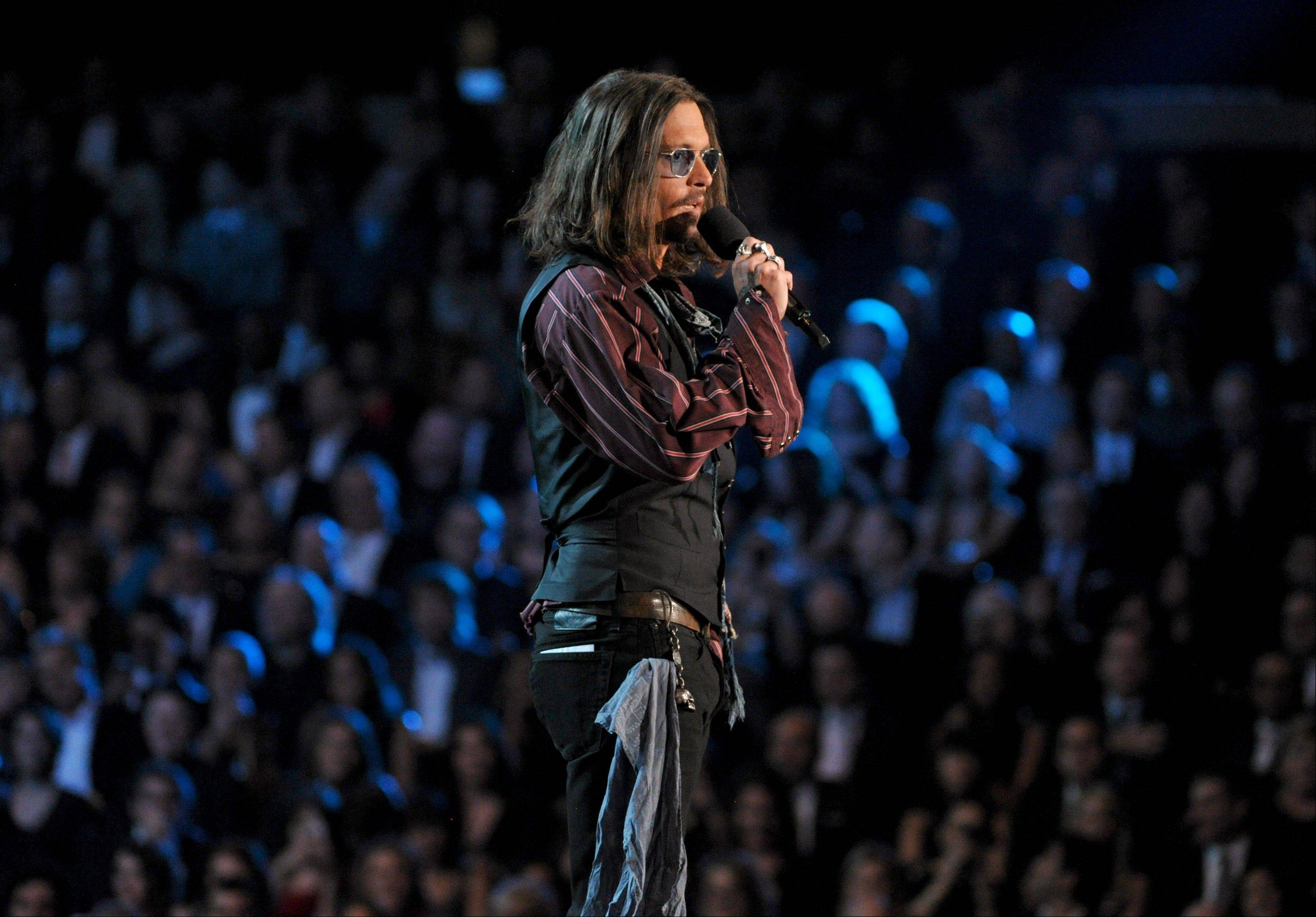 Actor Johnny Depp speaks on stage at the 55th annual Grammy Awards on Sunday, Feb. 10, 2013, in Los Angeles.