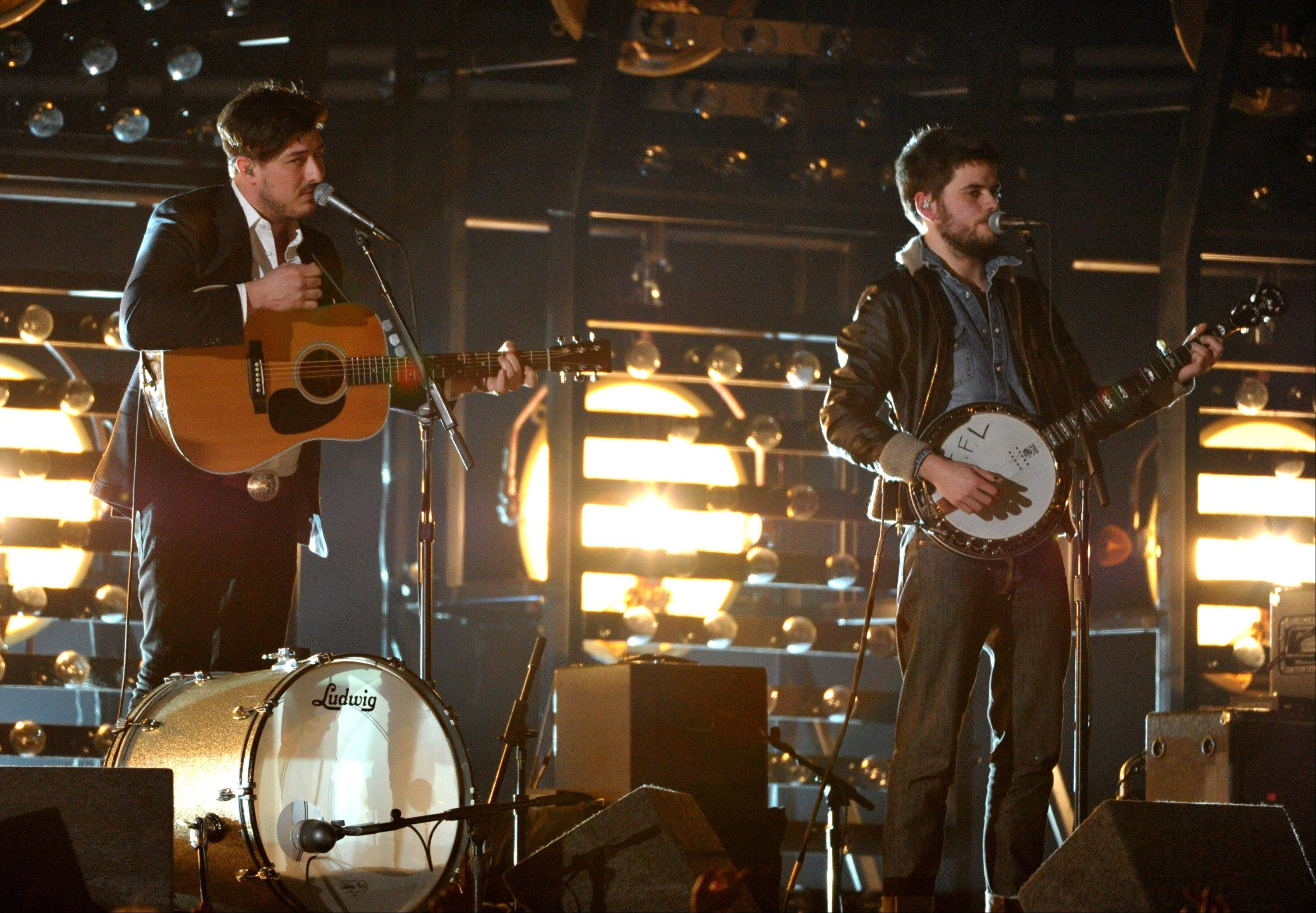 Marcus Mumford, left, and Winston Marshall, of Mumford & Sons, perform at the 55th annual Grammy Awards on Sunday, Feb. 10, 2013, in Los Angeles.