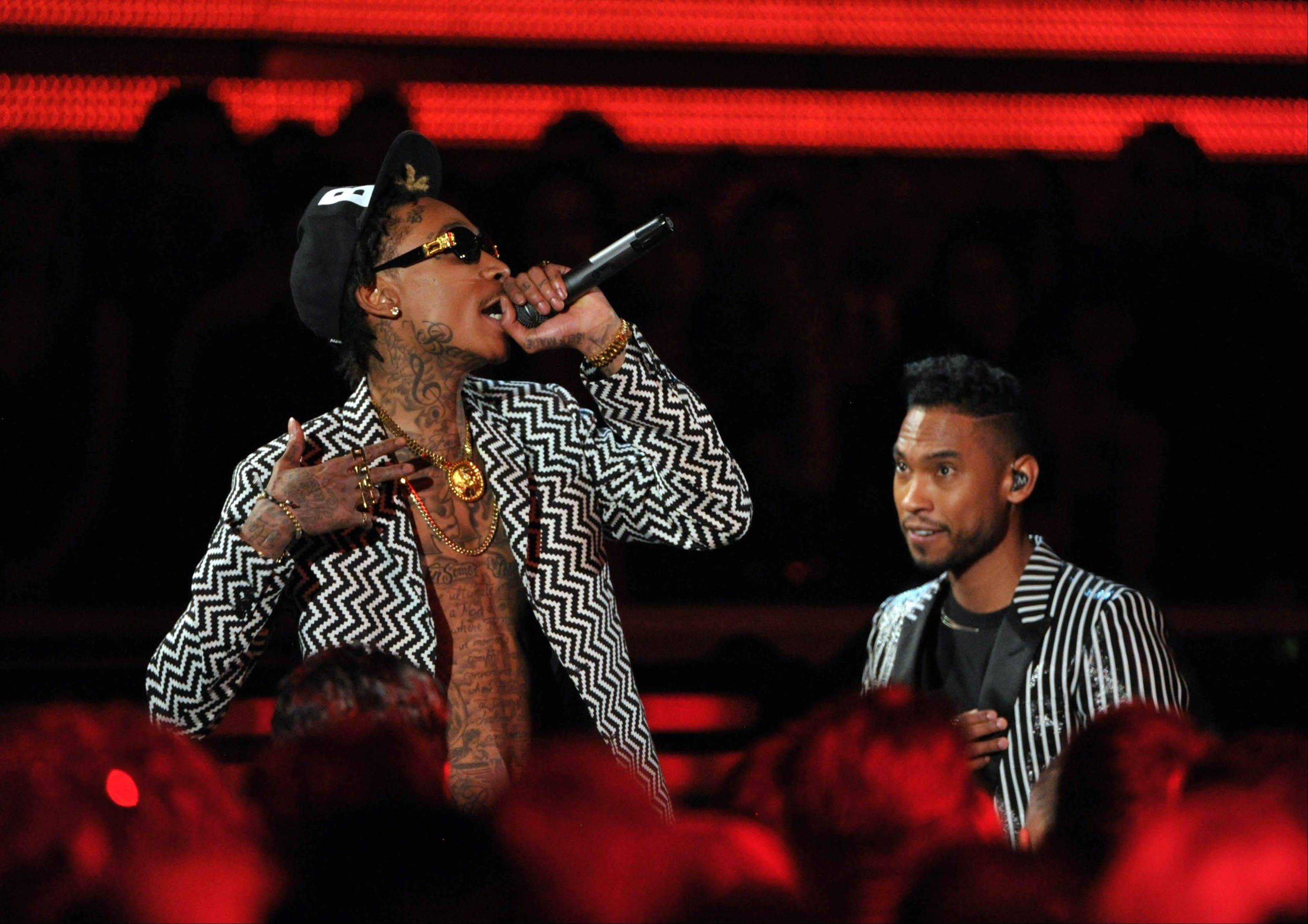 Musicians Wiz Khalifa, left, and Miguel perform at the 55th annual Grammy Awards on Sunday, Feb. 10, 2013, in Los Angeles.