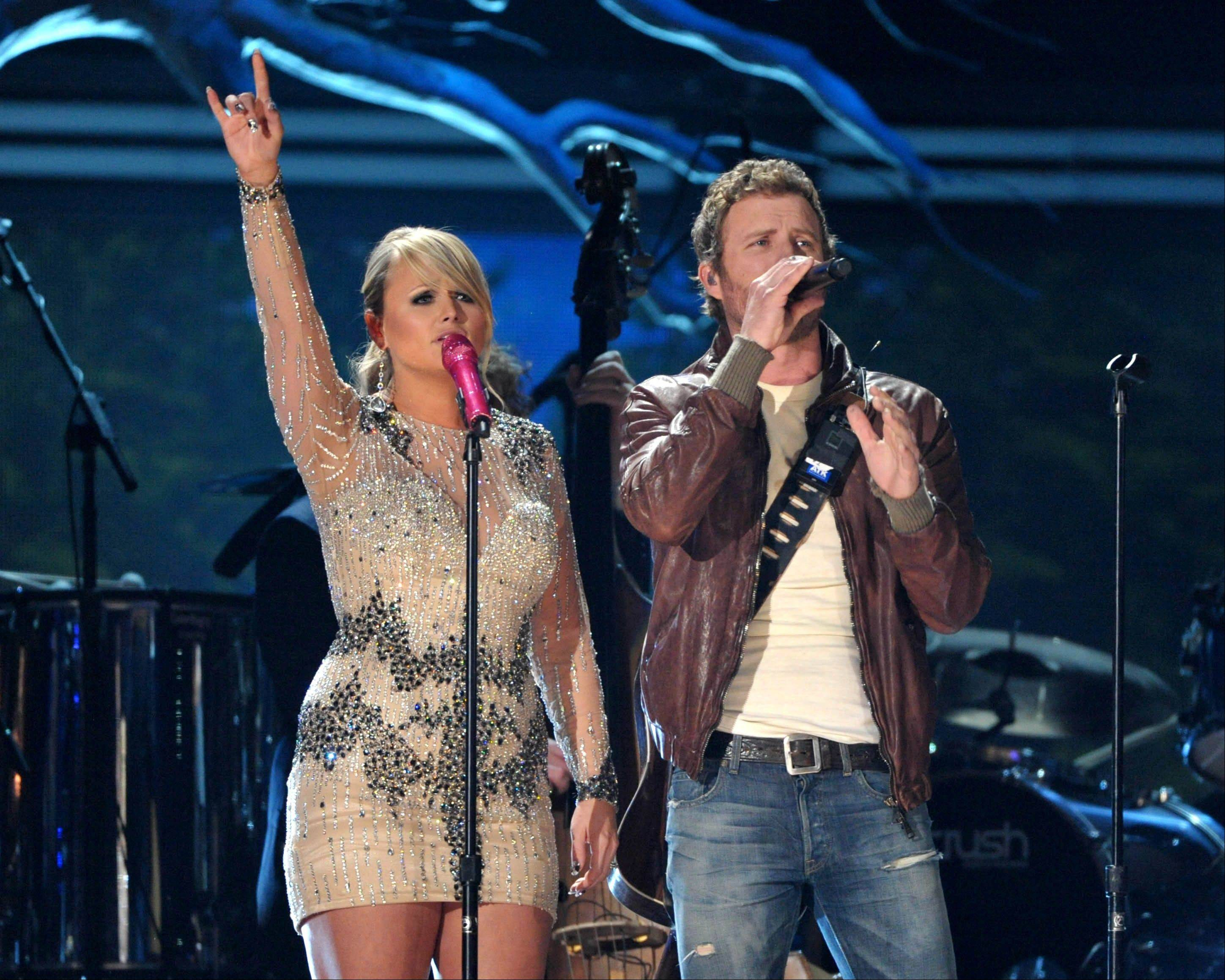 Country music stars Miranda Lambert, left, and Dierks Bentley perform at the 55th annual Grammy Awards on Sunday, Feb. 10, 2013, in Los Angeles.