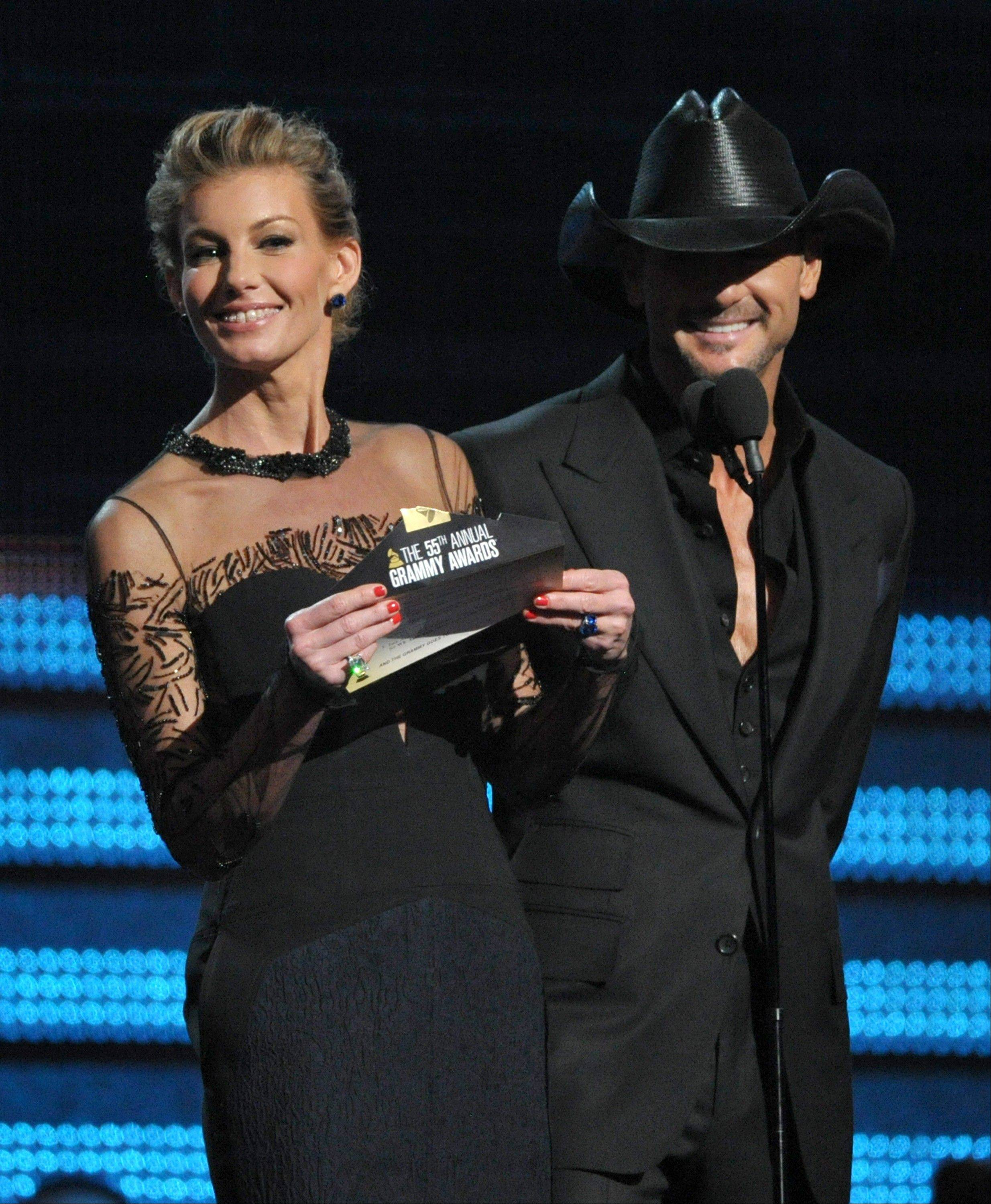 Country music stars Faith Hill and Tim McGraw present the award for song of the year at the 55th annual Grammy Awards on Sunday, Feb. 10, 2013, in Los Angeles.