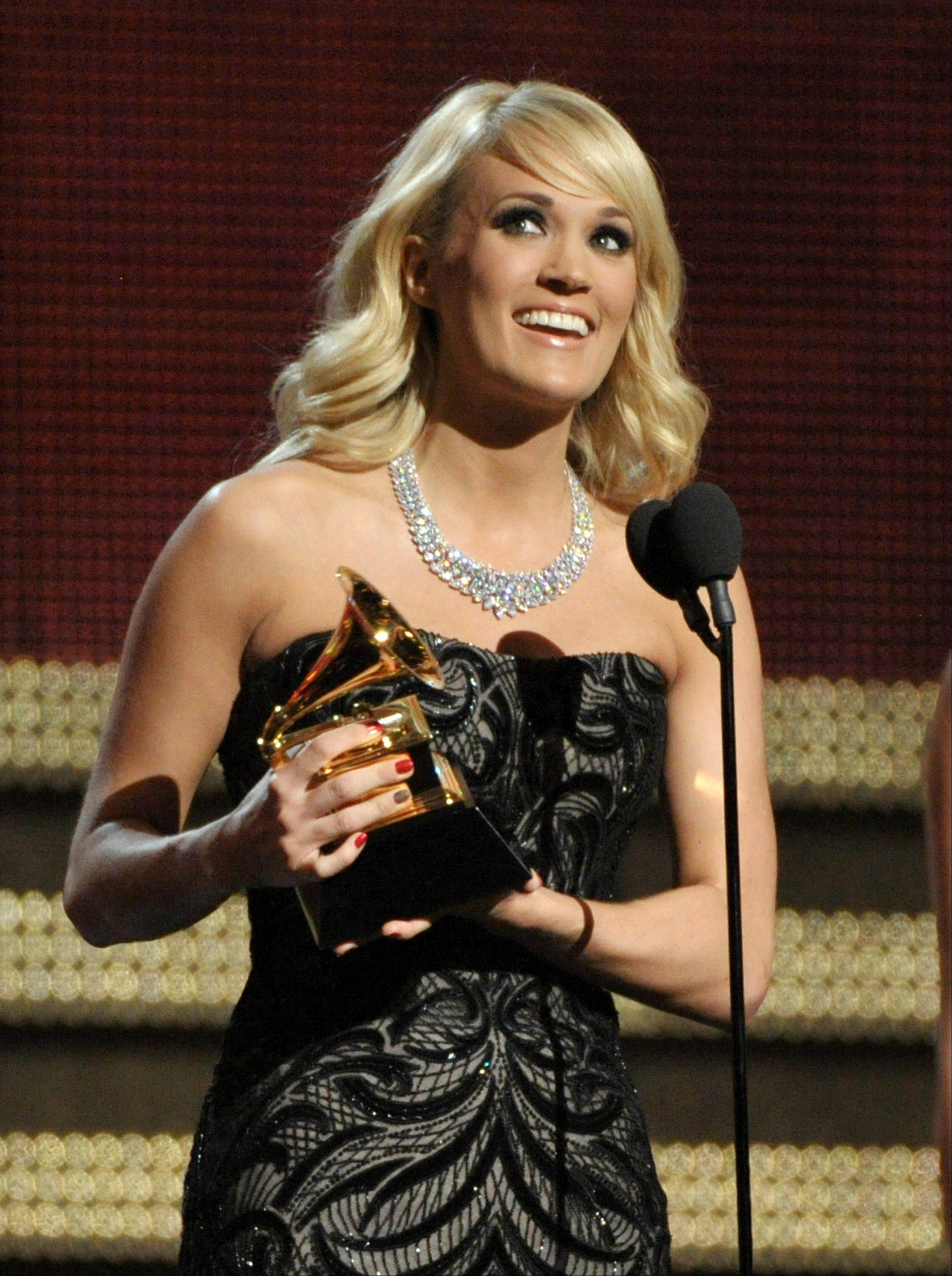 "Carrie Underwood accepts the award for best country solo performance for ""Blown Away"" at the 55th annual Grammy Awards on Sunday, Feb. 10, 2013, in Los Angeles."
