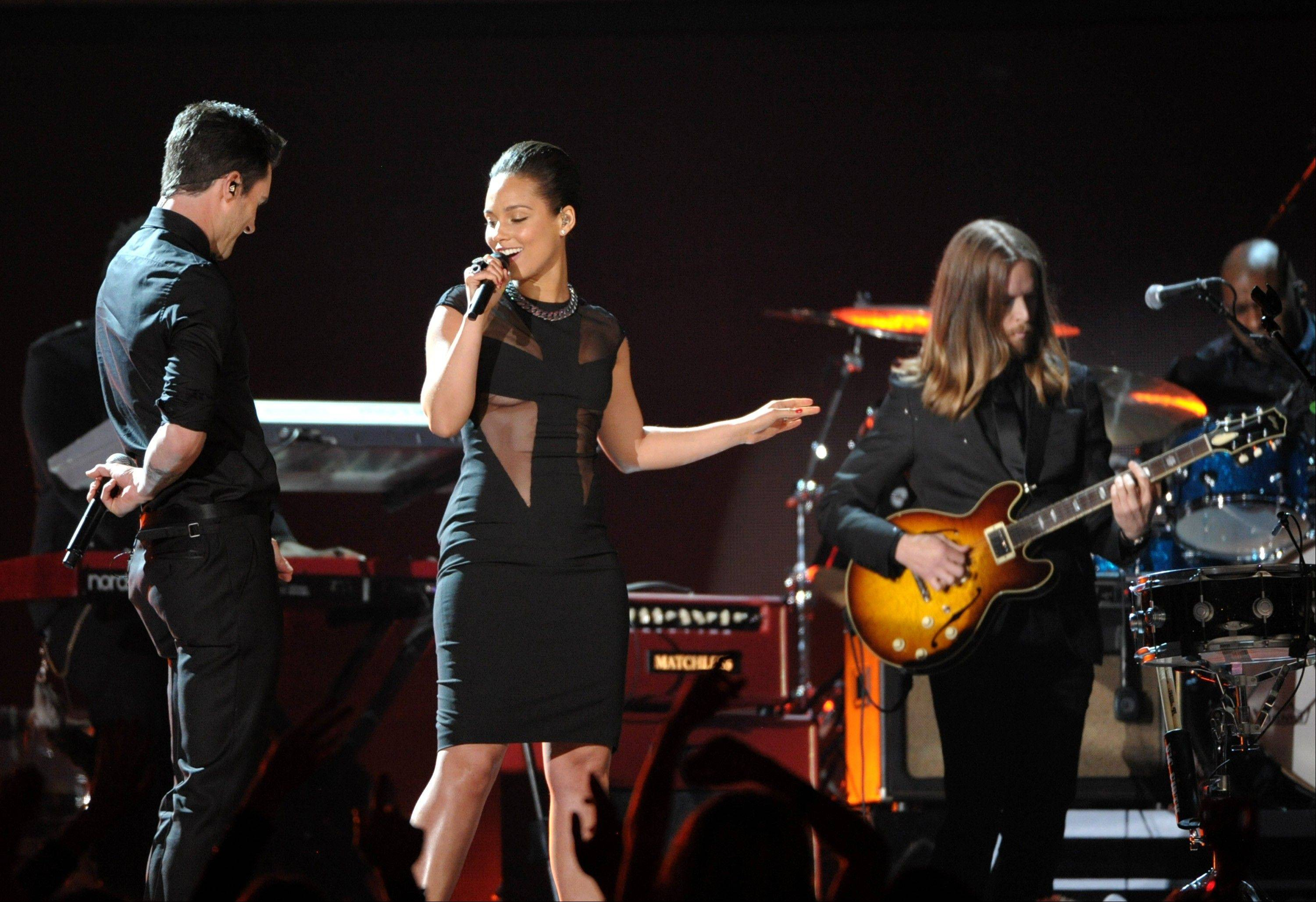 Adam Levine, left, of Maroon 5, and Alicia Keys perform at the 55th annual Grammy Awards on Sunday, Feb. 10, 2013, in Los Angeles. Looking on at right is James Valentine of Maroon 5.