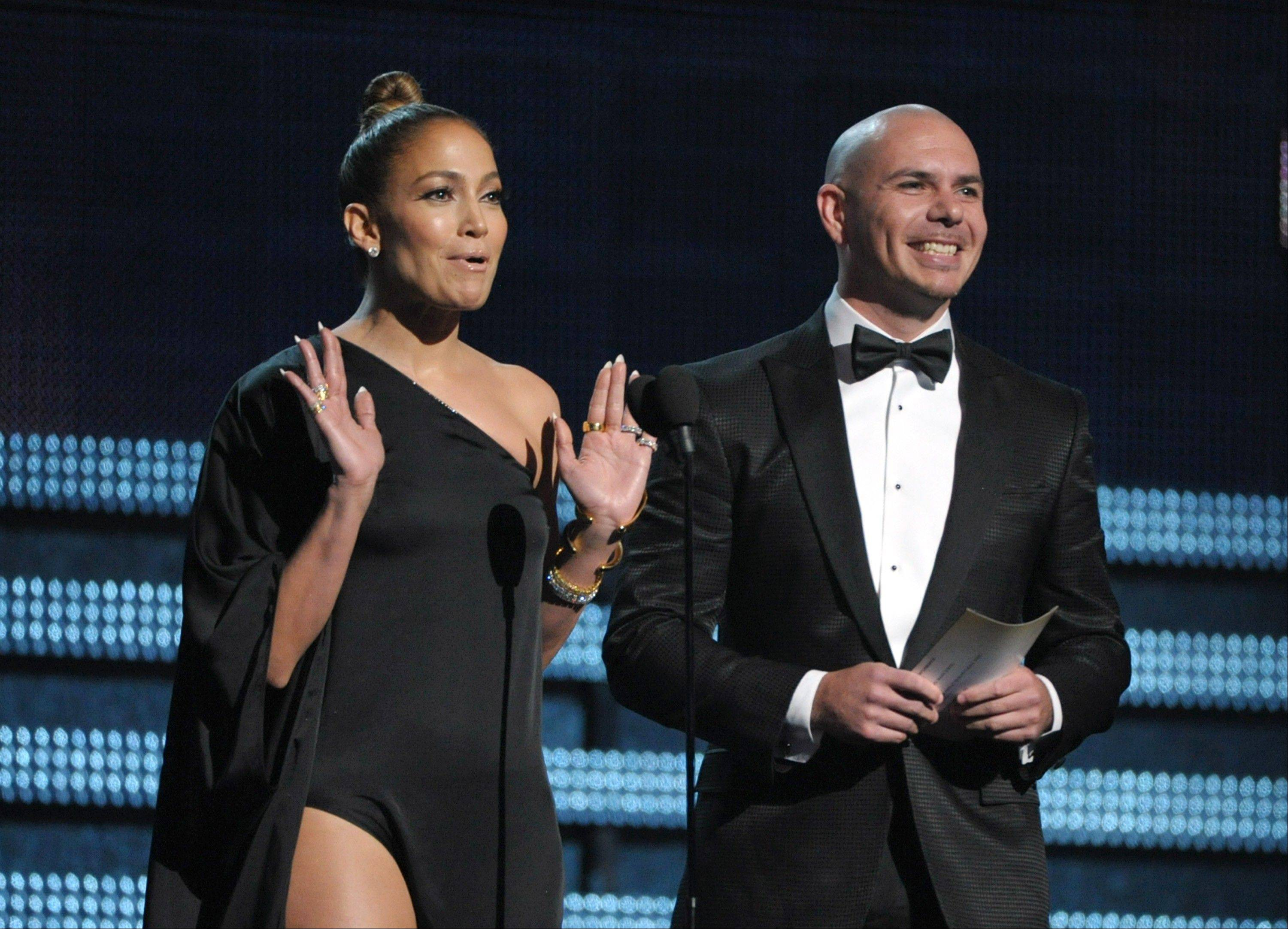 Jennifer Lopez and Pitbull present the award for best pop solo performance at the 55th annual Grammy Awards on Sunday, Feb. 10, 2013, in Los Angeles.