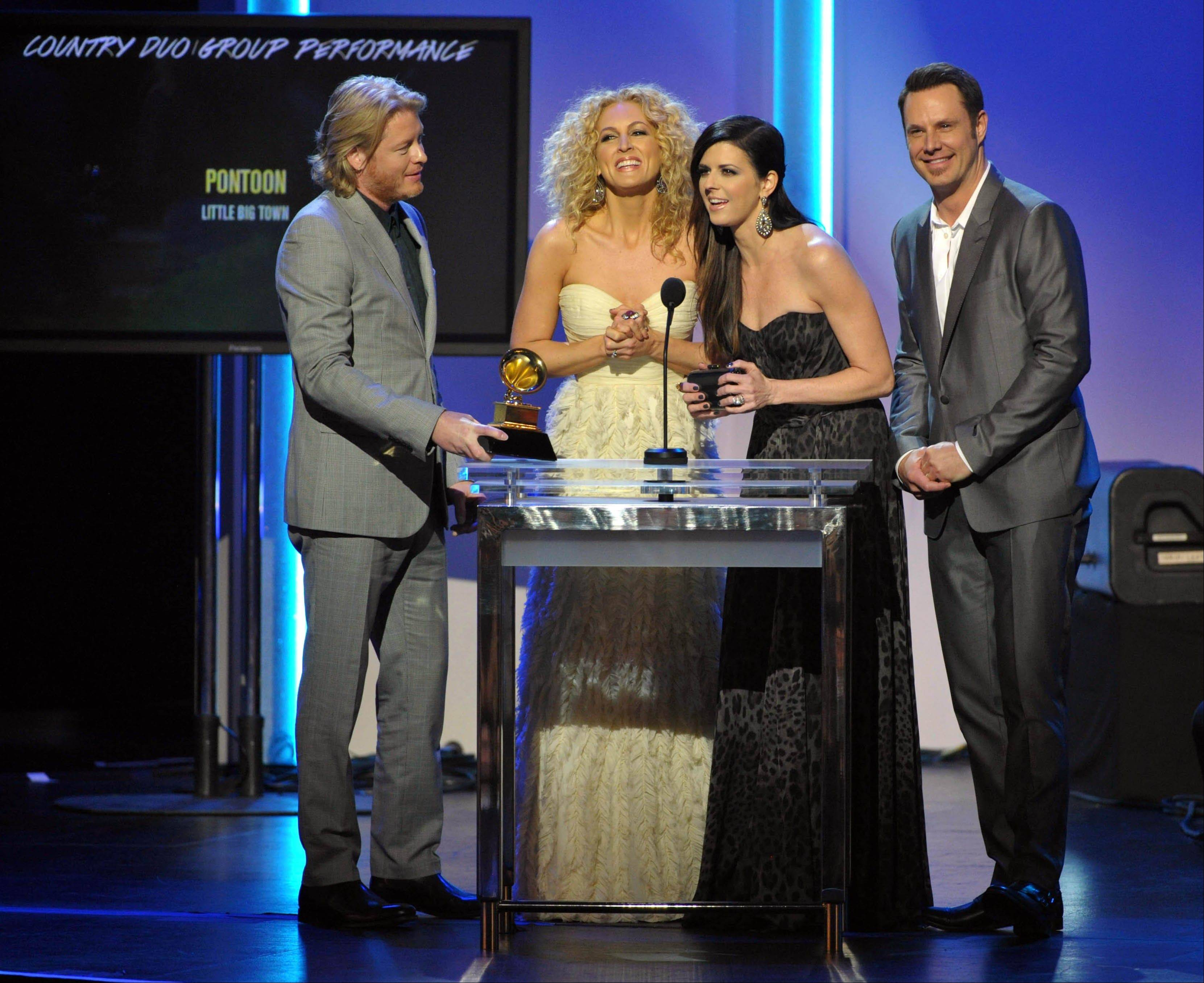 "Philip Sweet, from left, Kimberly Schlapman, Karen Fairchild, and Jimi Westbrook, of the band Little Big Town, accept the award for country duo/group performance for ""Pontoon"" during the pre-telecast at the 55th annual Grammy Awards on Sunday, Feb. 10, 2013, in Los Angeles."