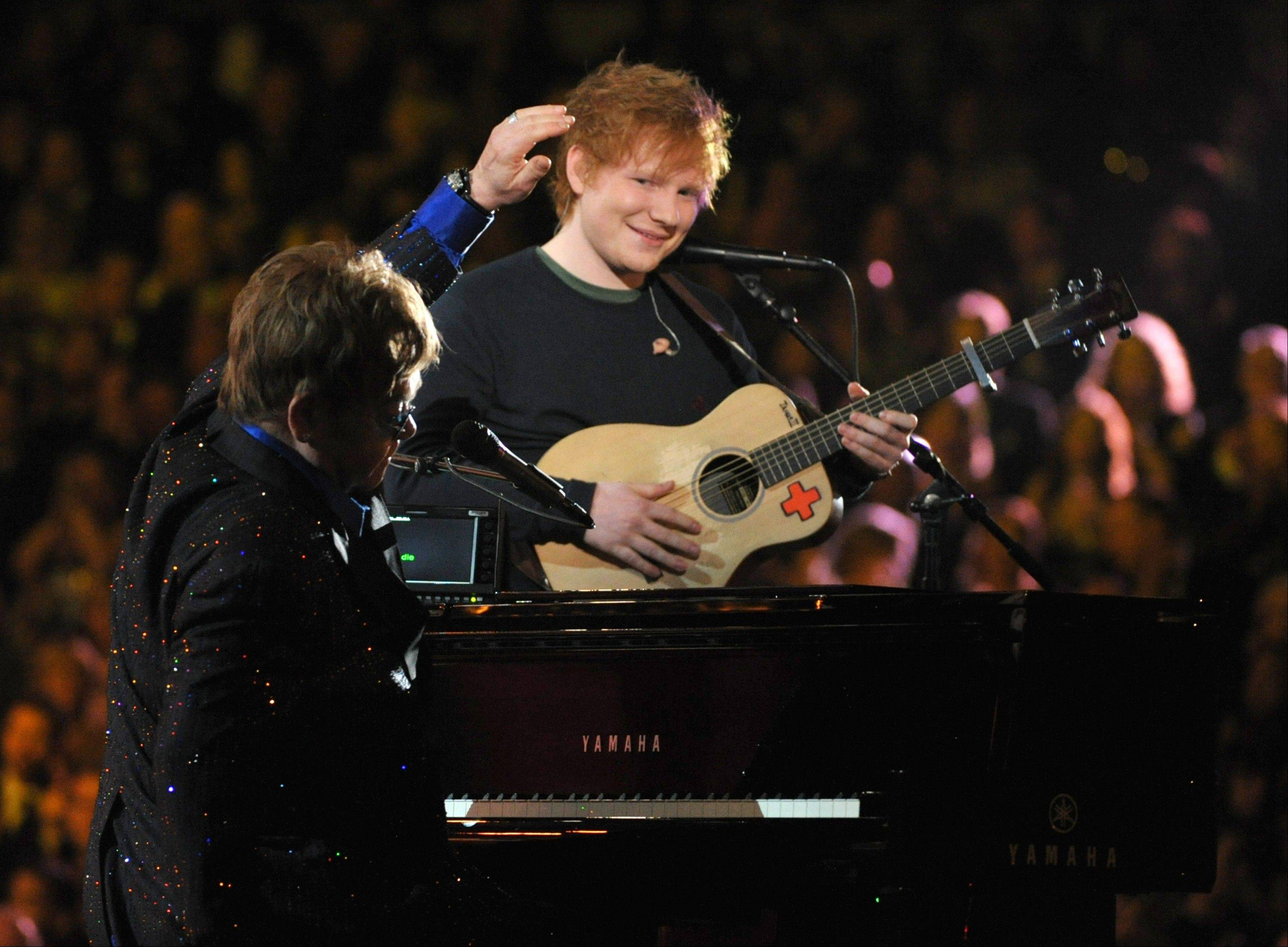 Sir Elton John, left, and Ed Sheeran perform on stage at the 55th annual Grammy Awards on Sunday, Feb. 10, 2013, in Los Angeles.