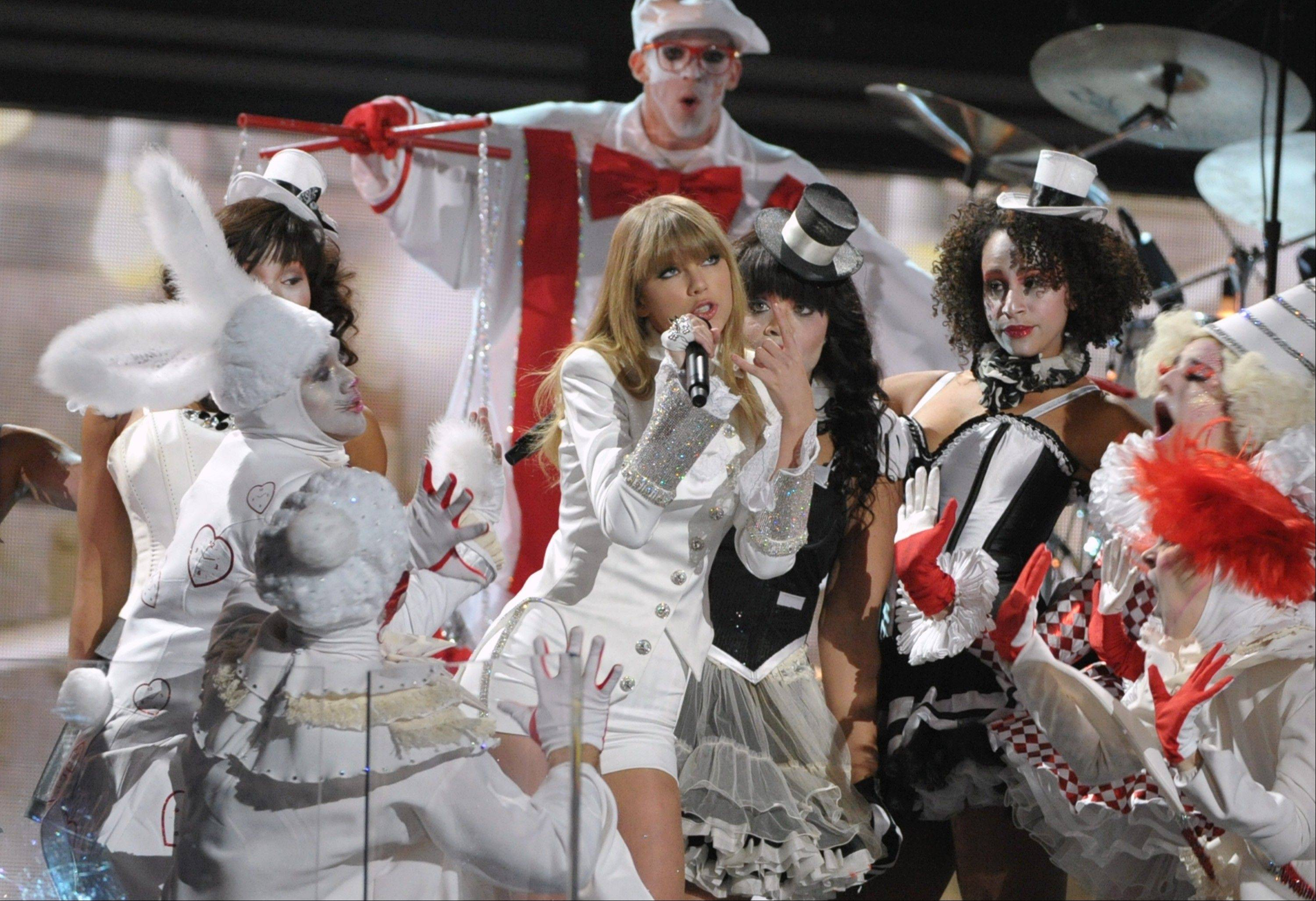 Taylor Swift performs during the opening of the 55th annual Grammy Awards on Sunday, Feb. 10, 2013, in Los Angeles.