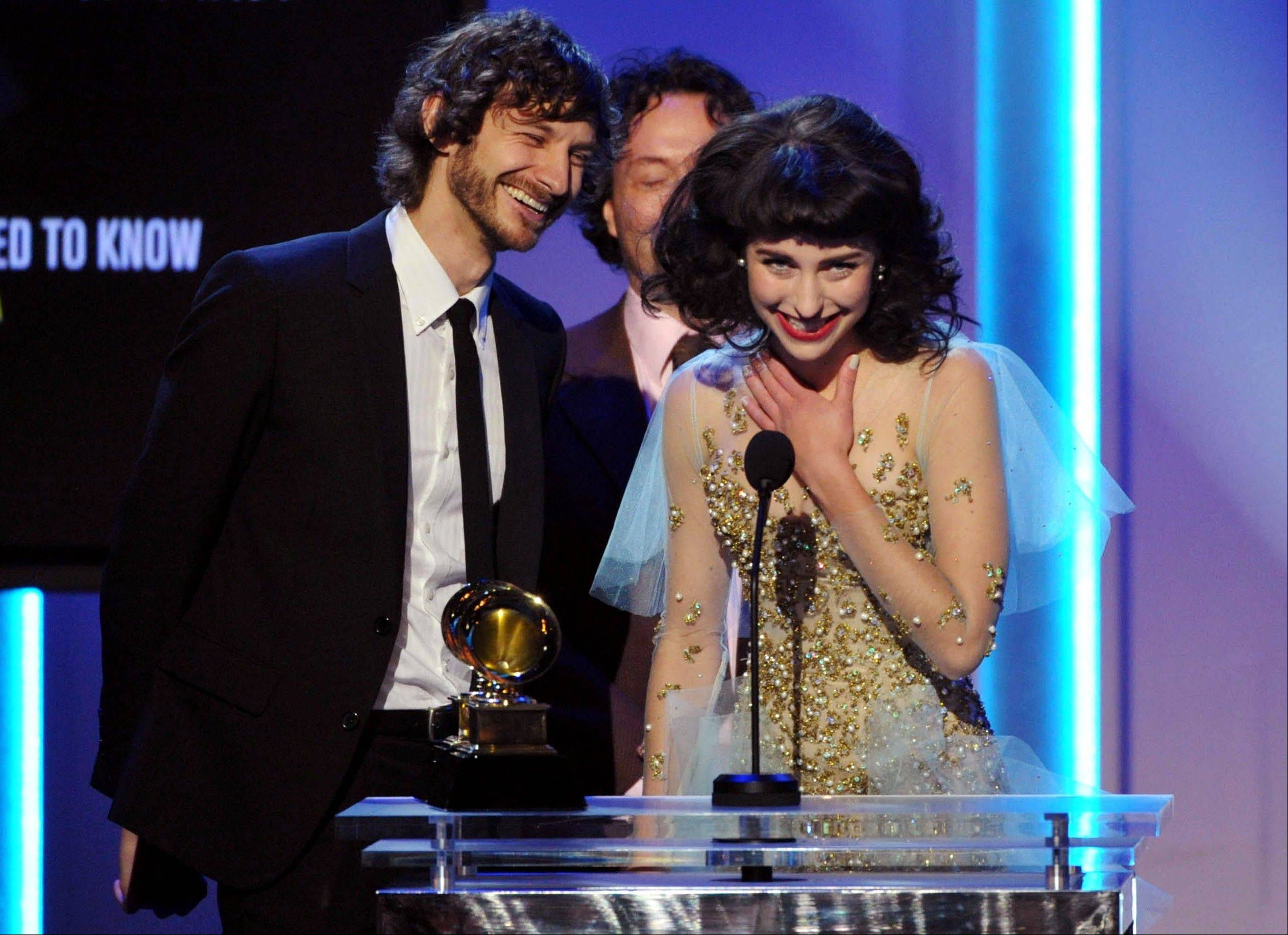 "Gotye, left, and Kimbra accept the award for best pop duo/group performance for ""Somebody That I Used to Know"" during the pre-telecast at the 55th annual Grammy Awards on Sunday, Feb. 10, 2013, in Los Angeles."