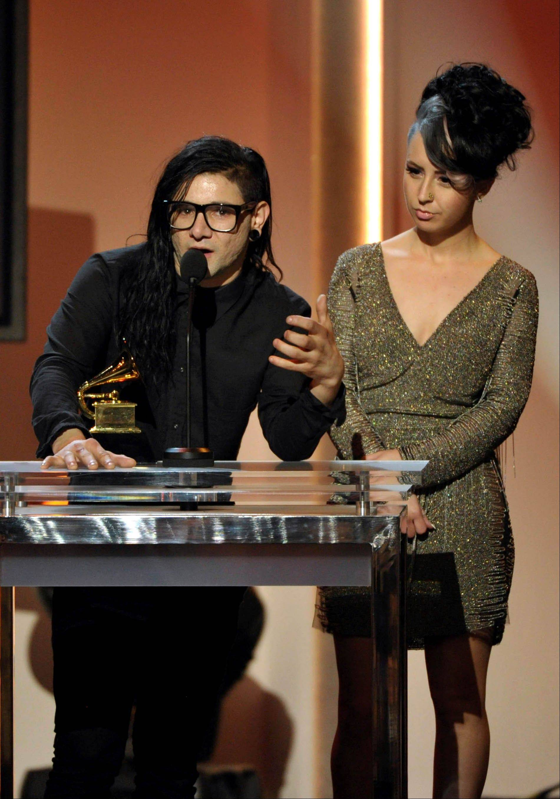 "Skrillex, left, and Sirah accept the award for best dance recording for ""Bangarang"" during the pre-telecast at the 55th annual Grammy Awards on Sunday, Feb. 10, 2013, in Los Angeles."