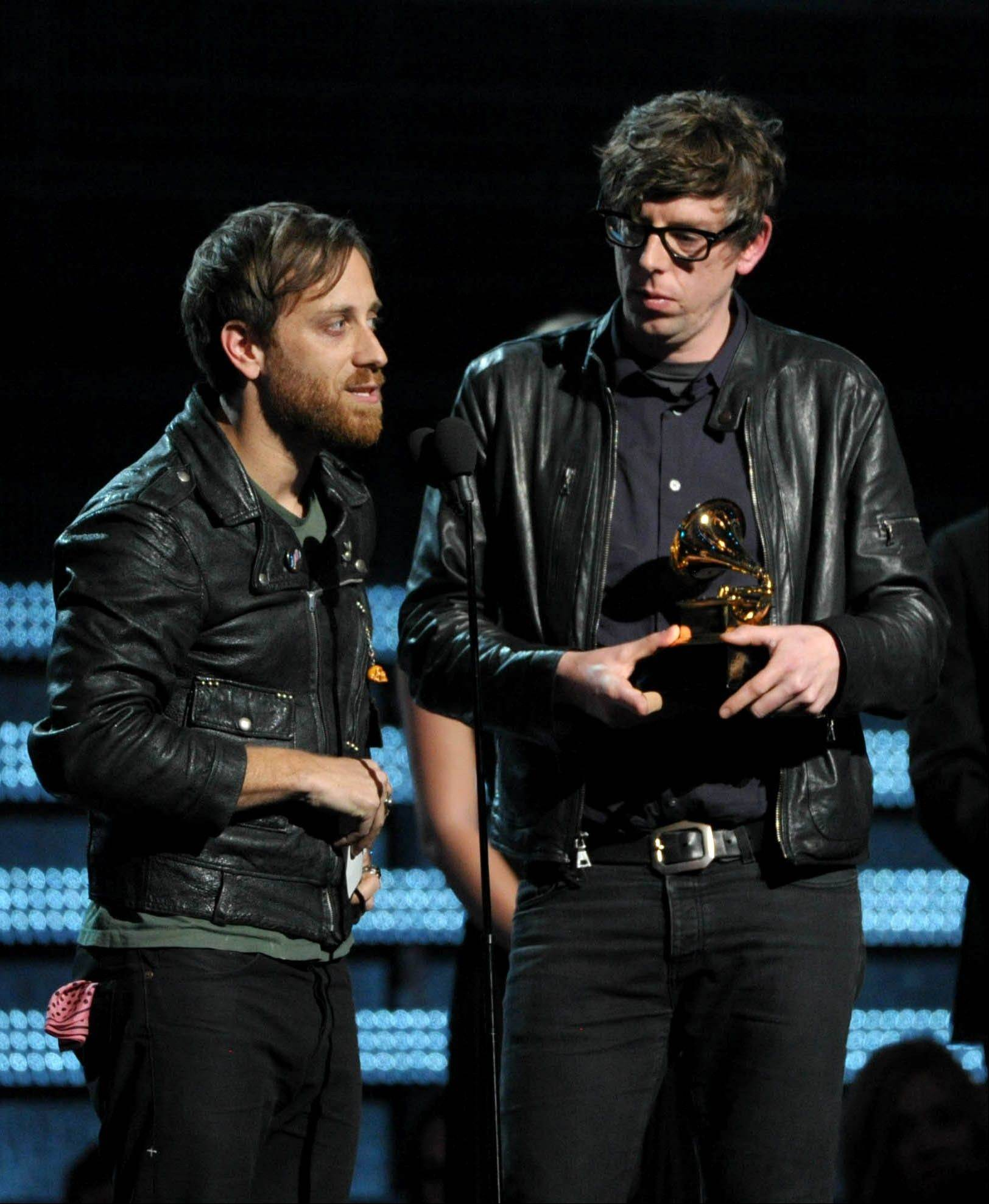 "Dan Auerbach, left, and Patrick Carney of the Black Keys accept the award for best rock performance for ""Lonely Boy"" at the 55th annual Grammy Awards on Sunday, Feb. 10, 2013, in Los Angeles."