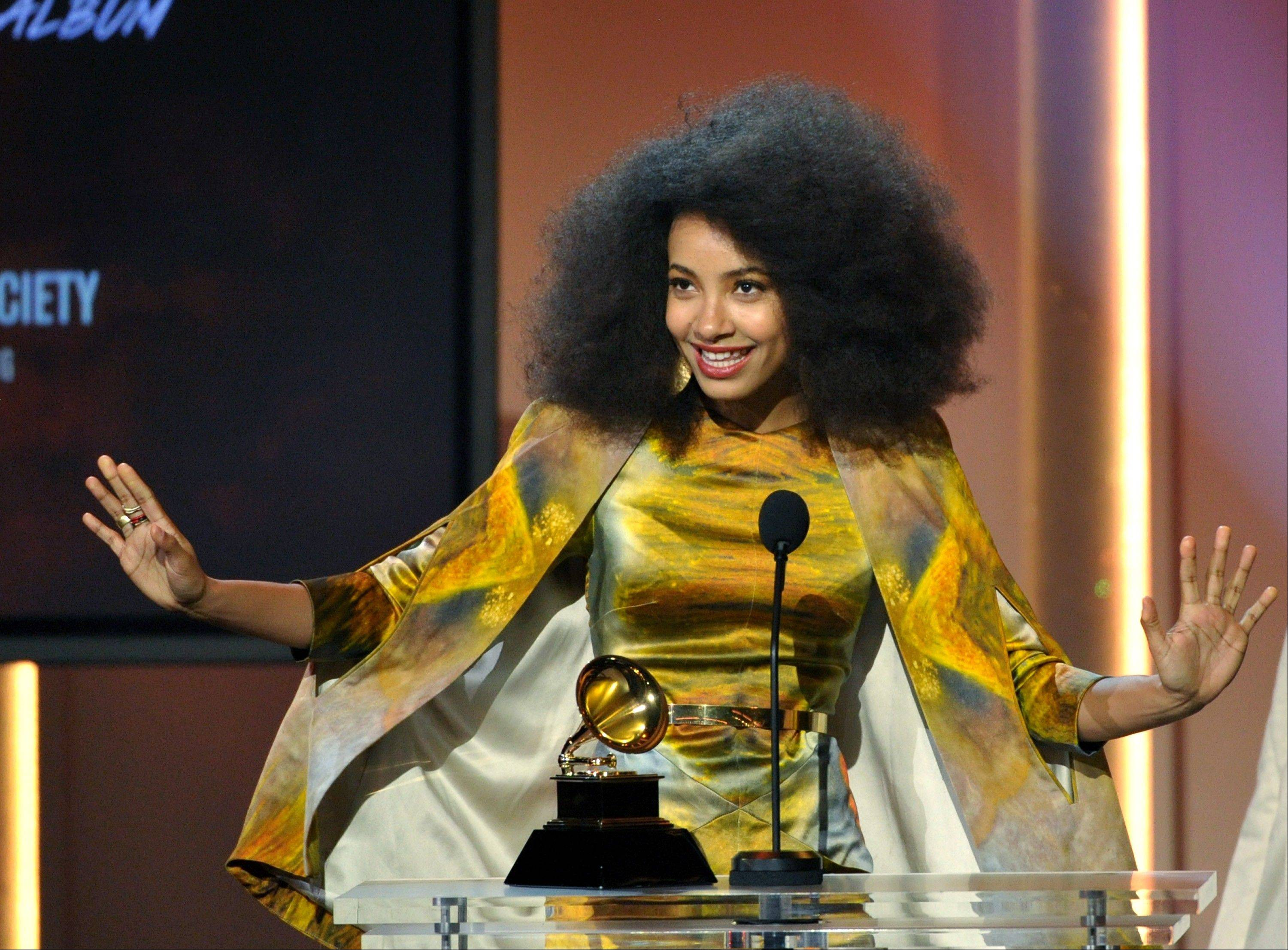 "Esperanza Spalding accepts the jazz vocal album for ""Radio Music Society"" at the 55th annual Grammy Awards on Sunday, Feb. 10, 2013, in Los Angeles."