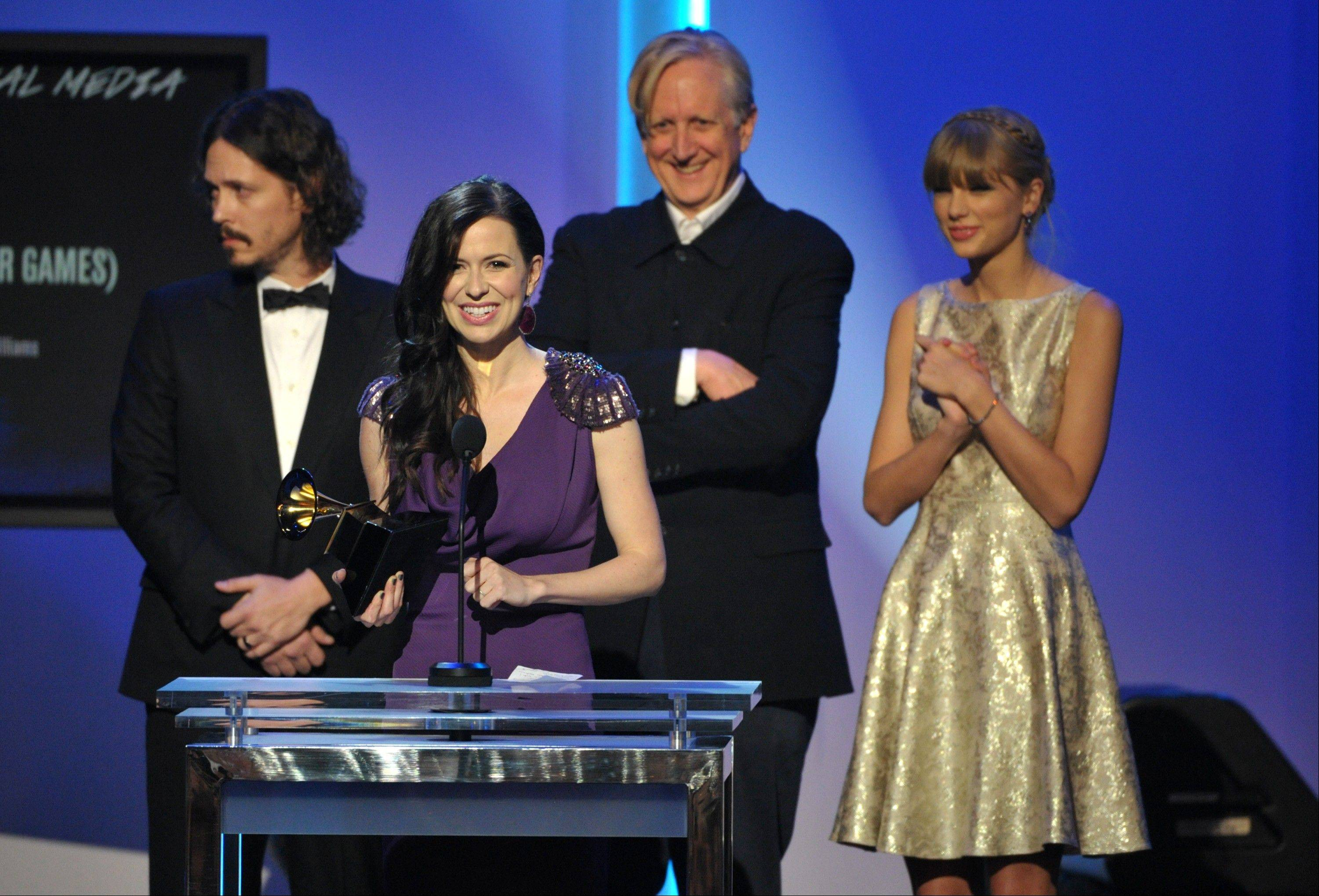"From left, John Paul White, Joy Williams, T Bone Burnett and Taylor Swift accept the award for song written for visual media for ""Safe and Sound"" (From The Hunger Games) at the 55th annual Grammy Awards on Sunday, Feb. 10, 2013, in Los Angeles."