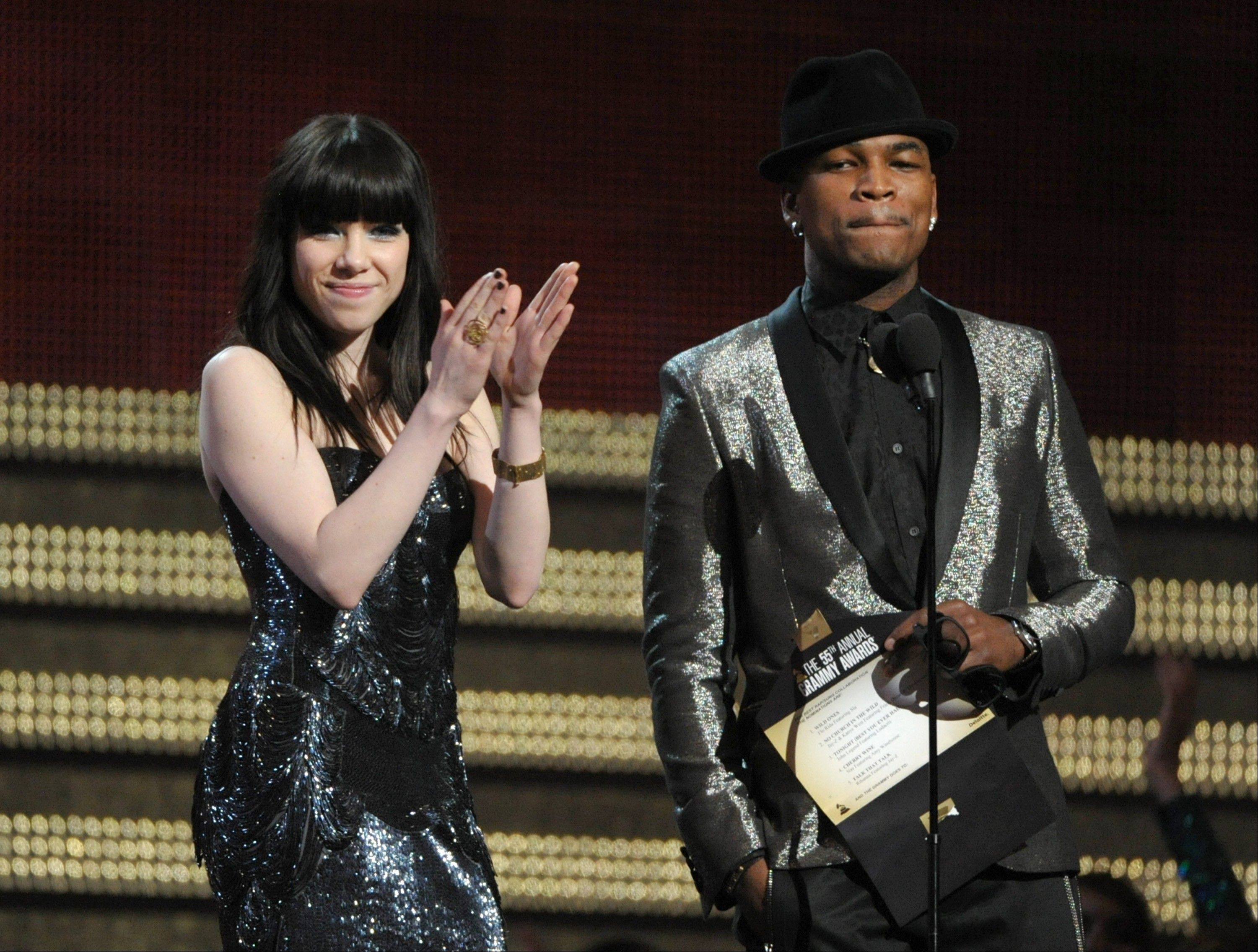 Carly Rae Jepsen, left, and Ne-Yo present the award for best rap/sung collaboration at the 55th annual Grammy Awards on Sunday, Feb. 10, 2013, in Los Angeles.