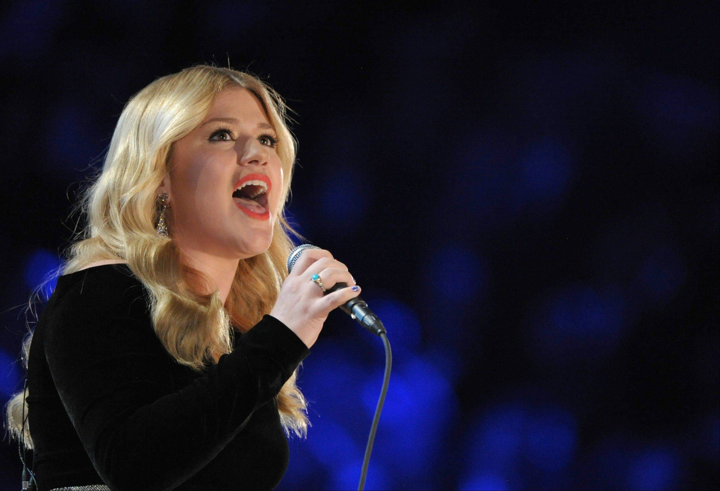 Kelly Clarkson performs on stage at the 55th annual Grammy Awards on Sunday, Feb. 10, 2013, in Los Angeles.