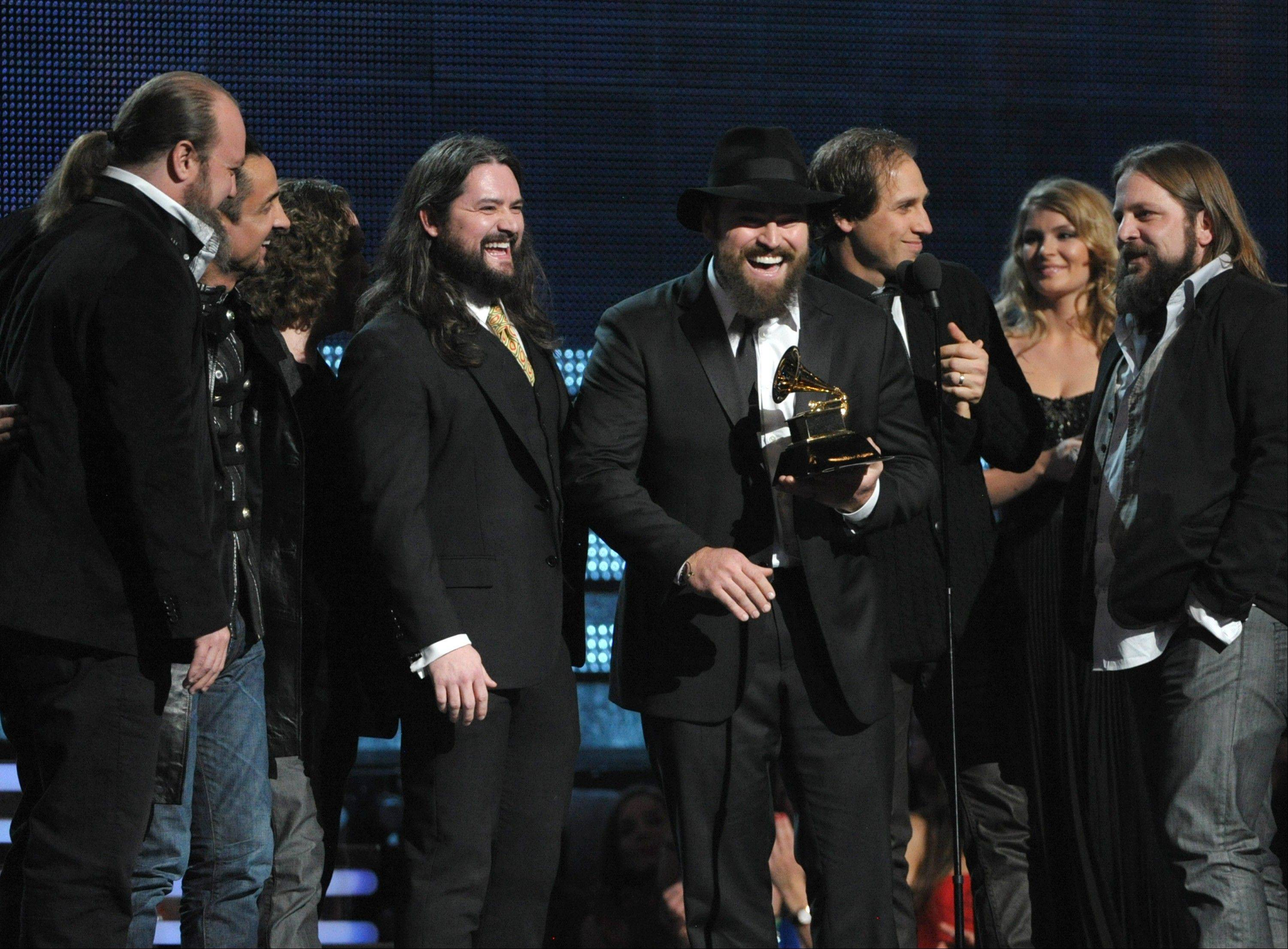 "Zac Brown, center, of the musical group Zac Brown Band accepts the award for best country album ""Uncaged"" at the 55th annual Grammy Awards on Sunday, Feb. 10, 2013, in Los Angeles."