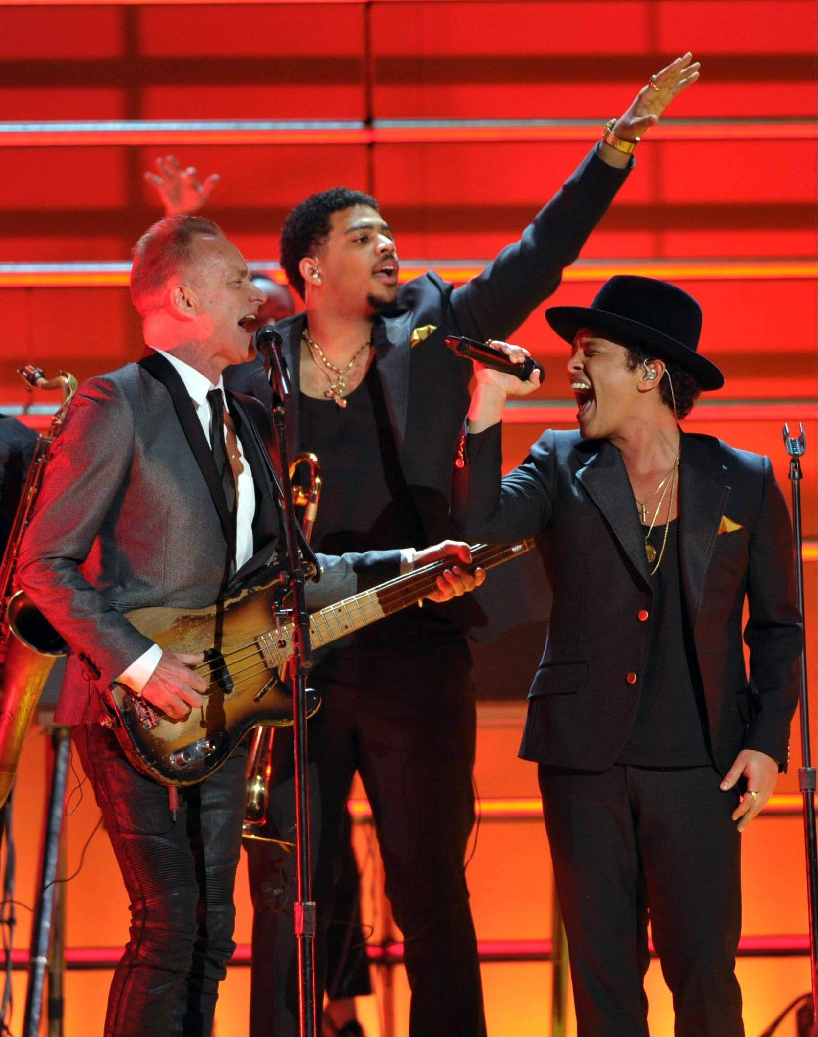 Musicians Sting, left, and Bruno Mars perform a tribute to Bob Marley at the 55th annual Grammy Awards on Sunday, Feb. 10, 2013, in Los Angeles.
