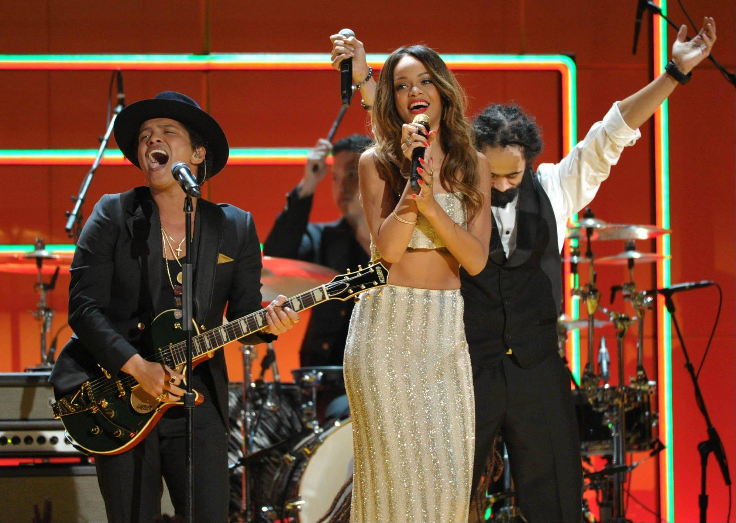 Bruno Mars, left, and Rihanna perform a tribute to Bob Marley at the 55th annual Grammy Awards on Sunday, Feb. 10, 2013, in Los Angeles.