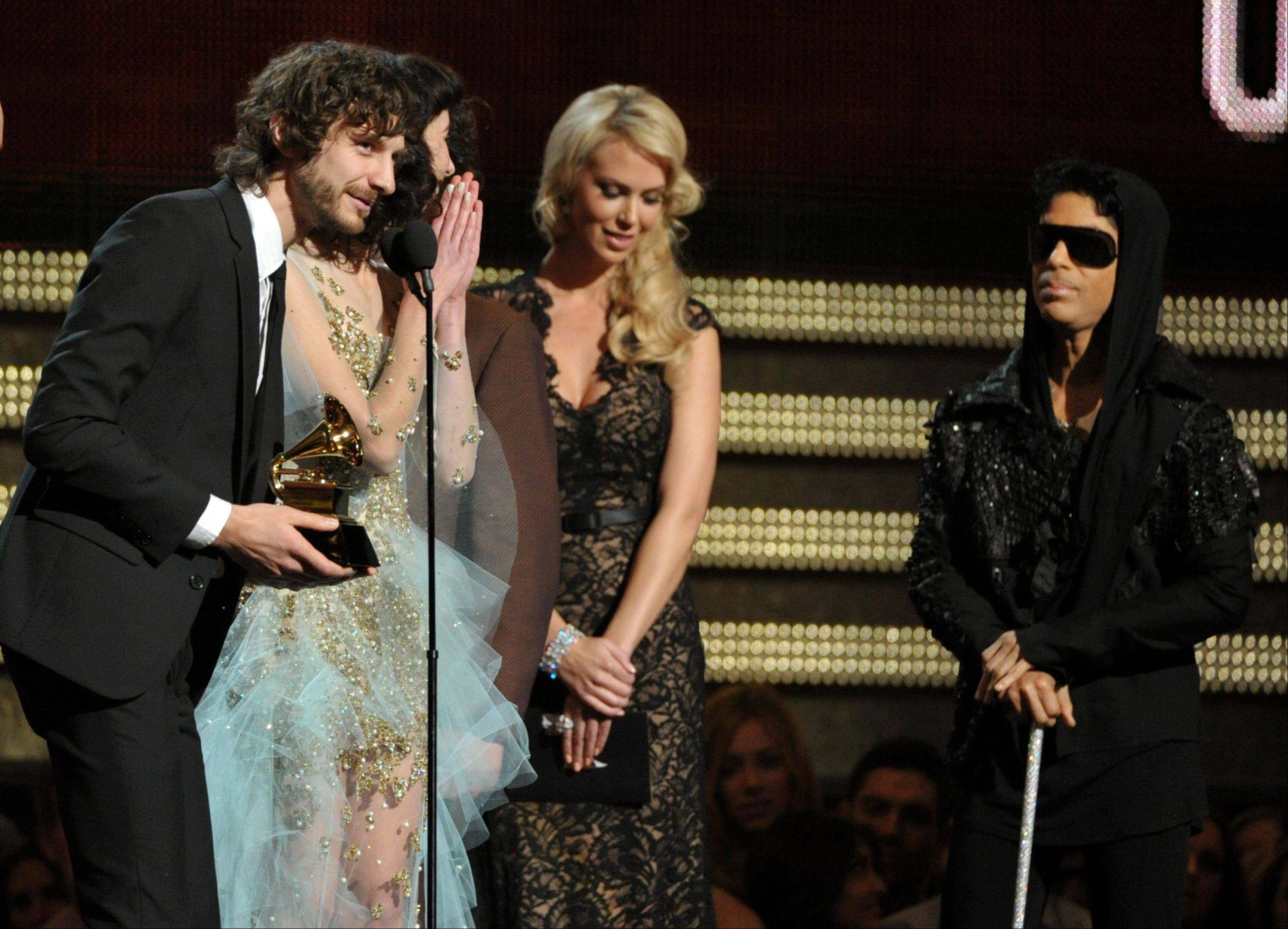 "Gotye, left, and Kimbra accept the award for record of the year for ""Somebody That I Used to Know"" at the 55th annual Grammy Awards on Sunday, Feb. 10, 2013, in Los Angeles. Looking on from right is presenter Prince."