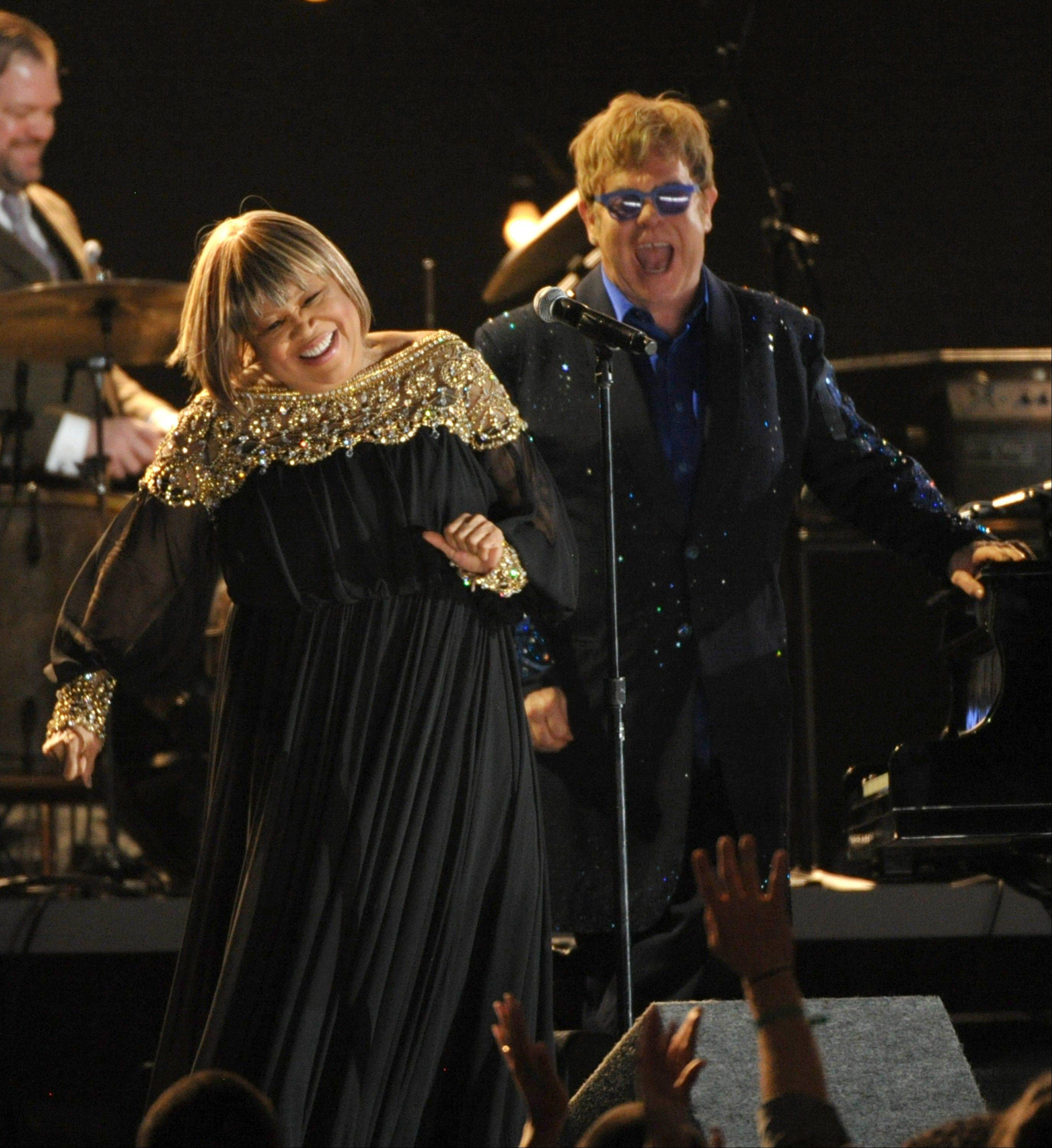 Mavis Staples, left, and Elton John perform a tribute to Levon Helm at the 55th annual Grammy Awards on Sunday, Feb. 10, 2013, in Los Angeles.
