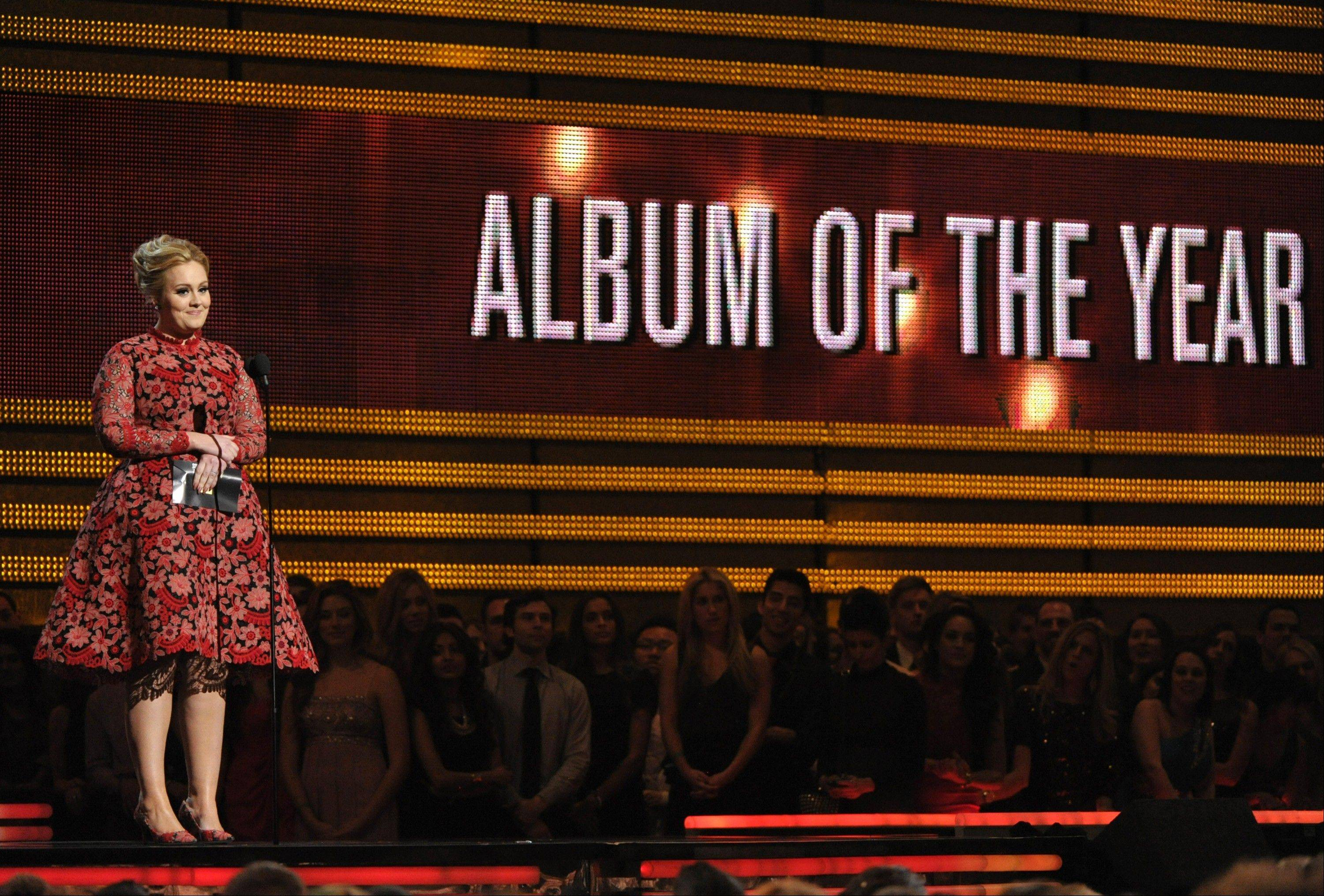 Adele presents the award for album of the year at the 55th annual Grammy Awards on Sunday, Feb. 10, 2013, in Los Angeles.