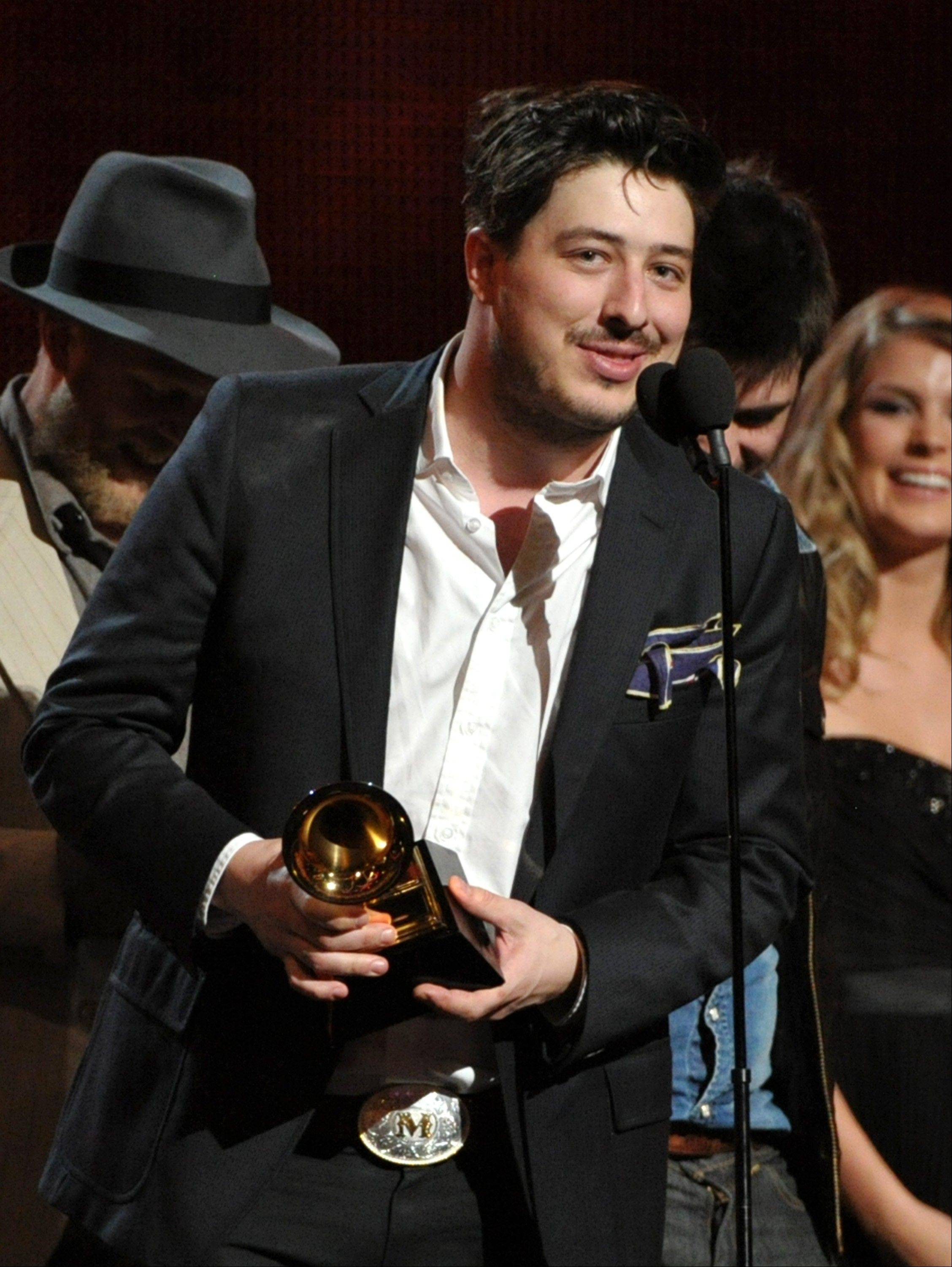 "Marcus Mumford accepts the award on stage for album of the year for ""Babel"" by Mumford & Sons at the 55th annual Grammy Awards on Sunday, Feb. 10, 2013, in Los Angeles."